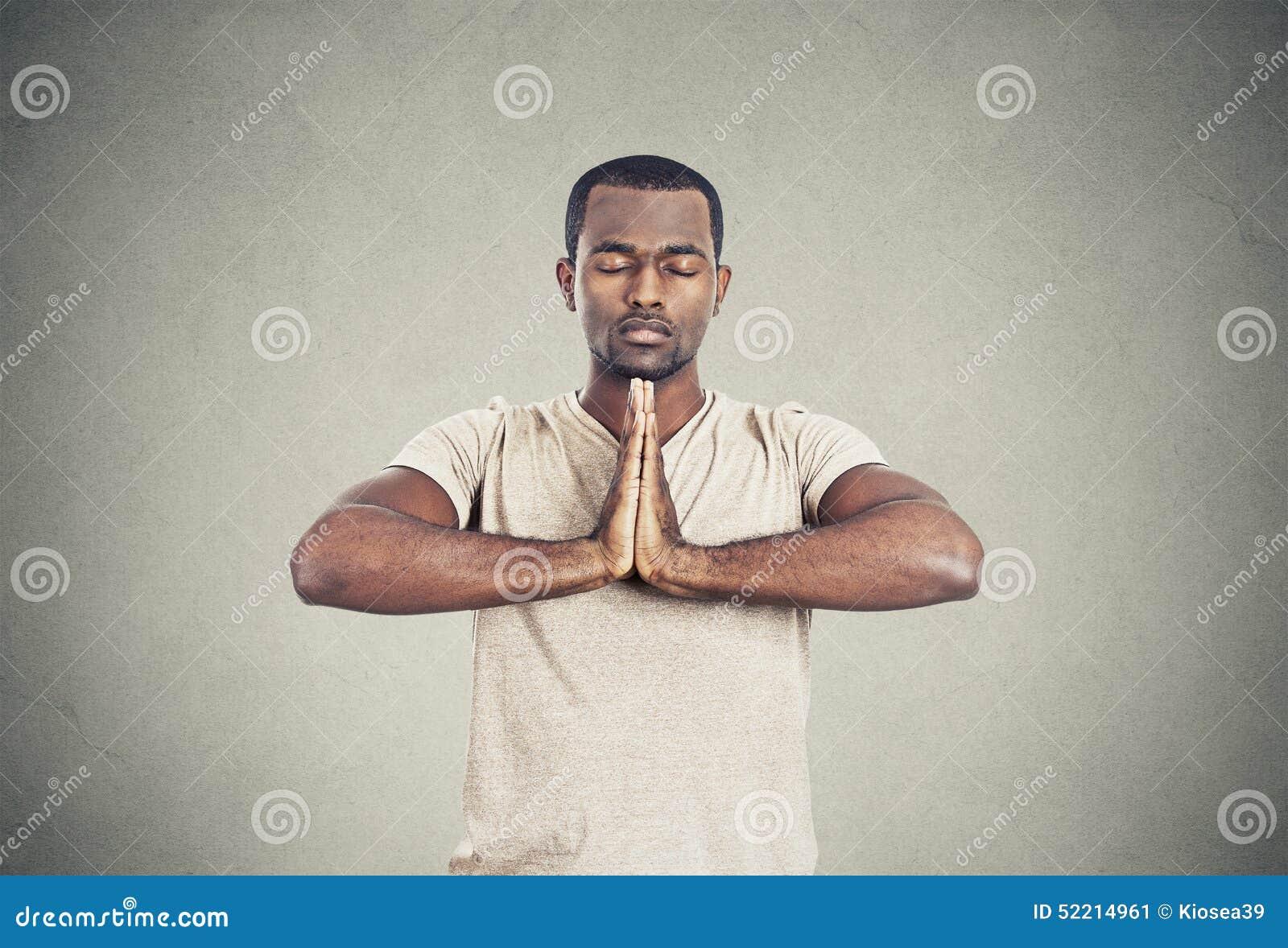 Handsome man doing yoga