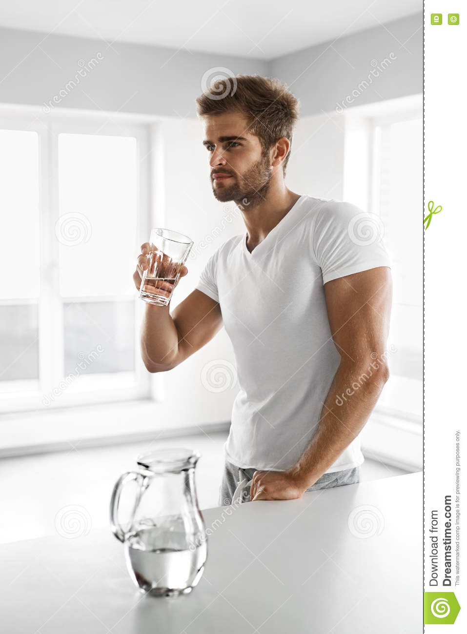 f754648d779b Drinking Water. Closeup Portrait Of Handsome Young Man With Fit Body  Drinking Fresh Water From Glass In Morning. Thirsty Fitness Male Model  Enjoying ...