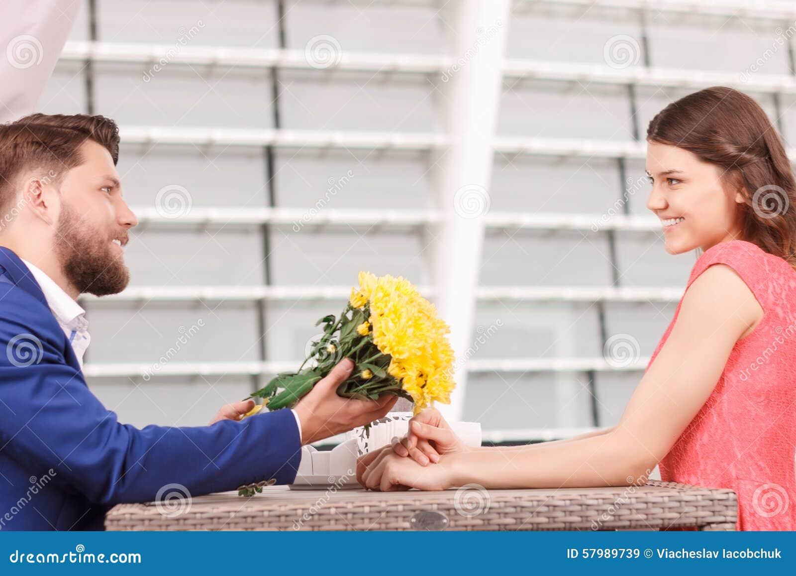 Handsome man giving flowers to his girlfriend stock image image of handsome man giving flowers to his girlfriend mightylinksfo