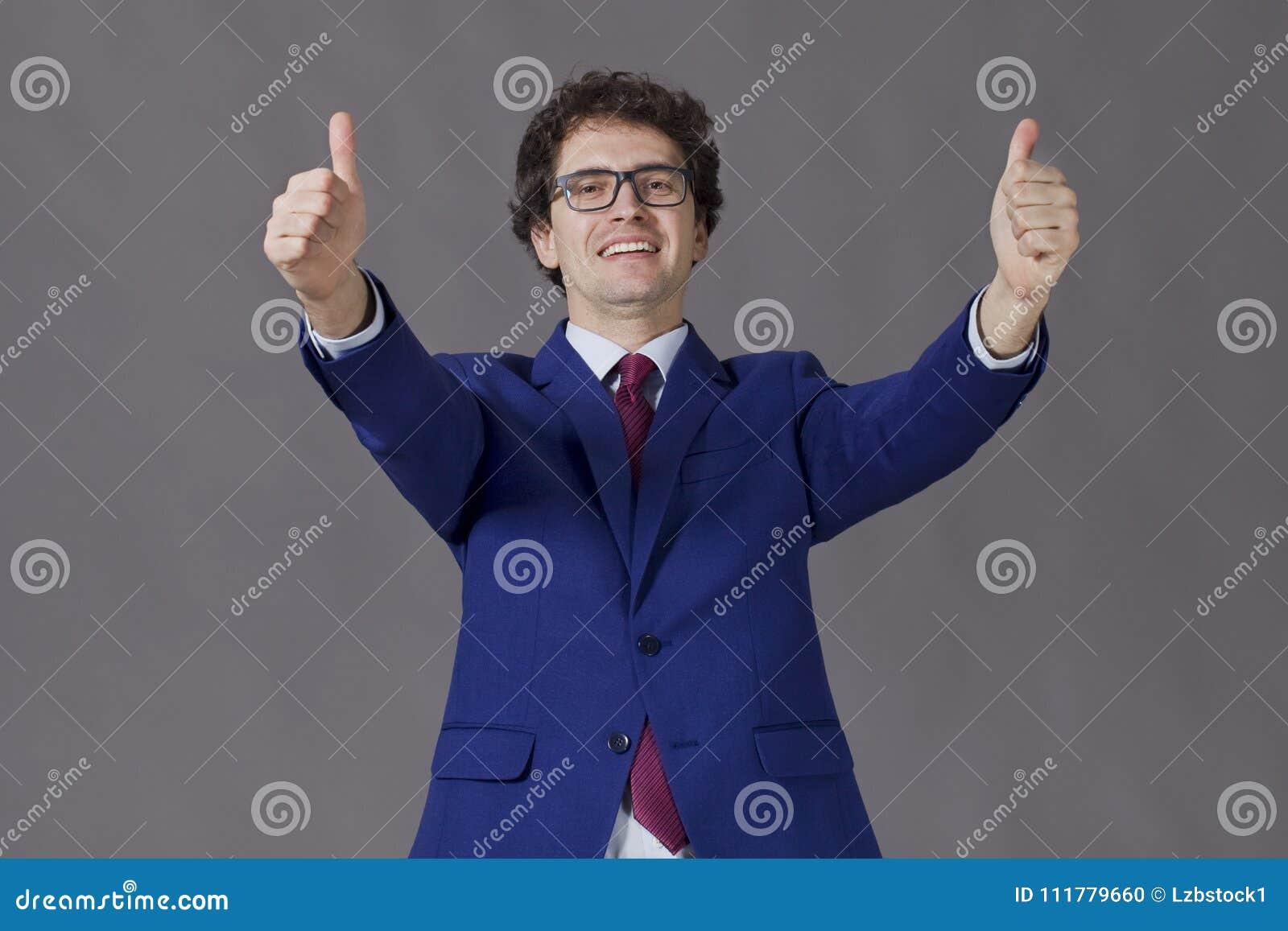 Happy handsome man showing big thumbs up