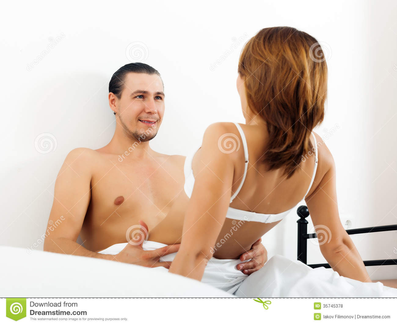 man and woman in bed nude