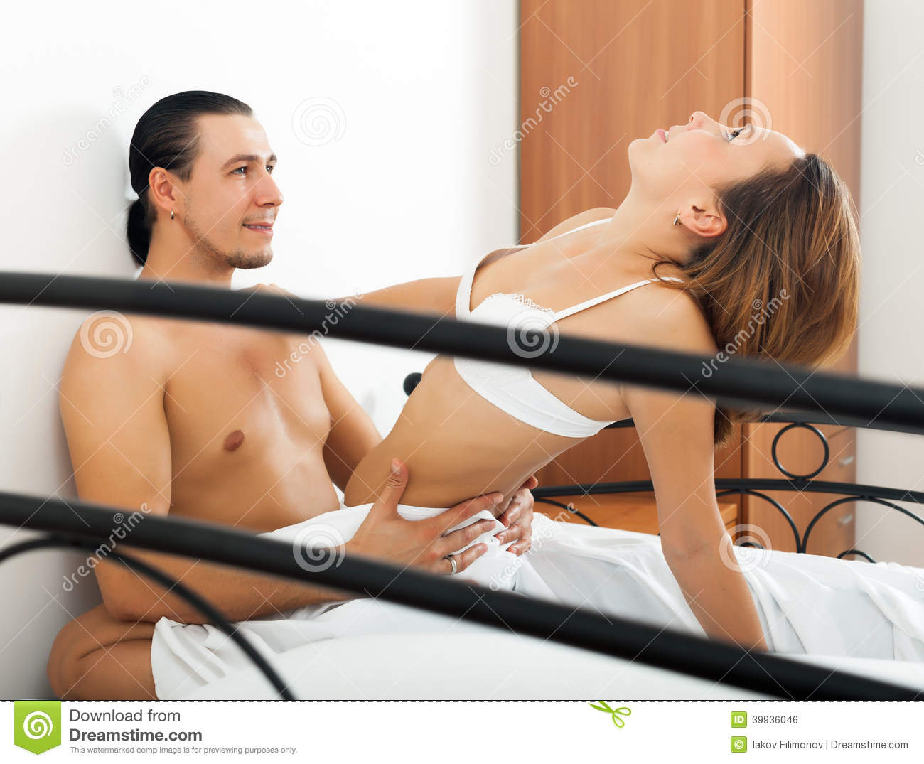 handsome man having sex with woman stock photo - image of home