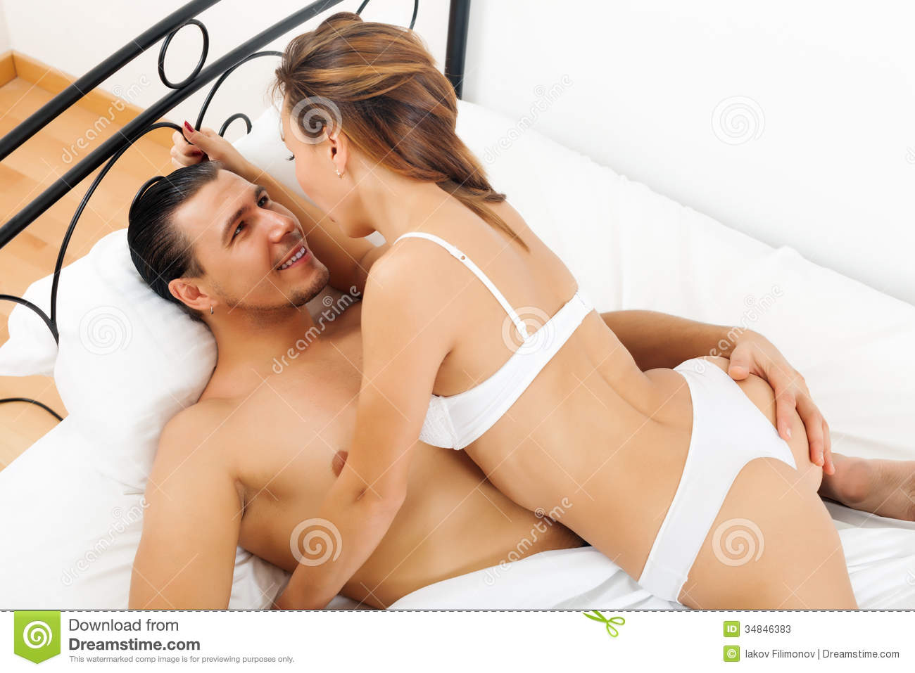 Male And Female Having Sex In Bed