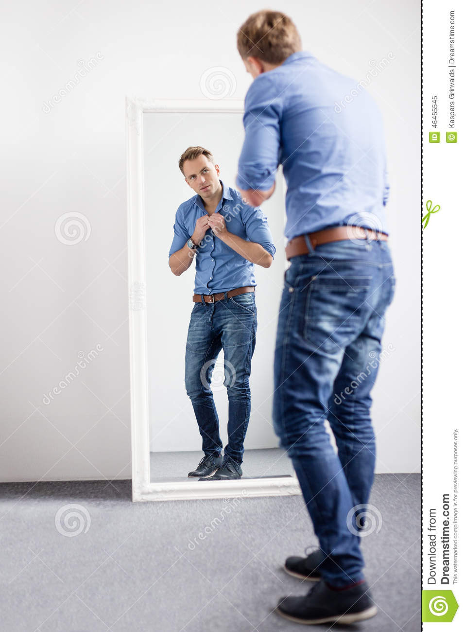 Handsome Man Looking At Himself In Mirror Stock Photo