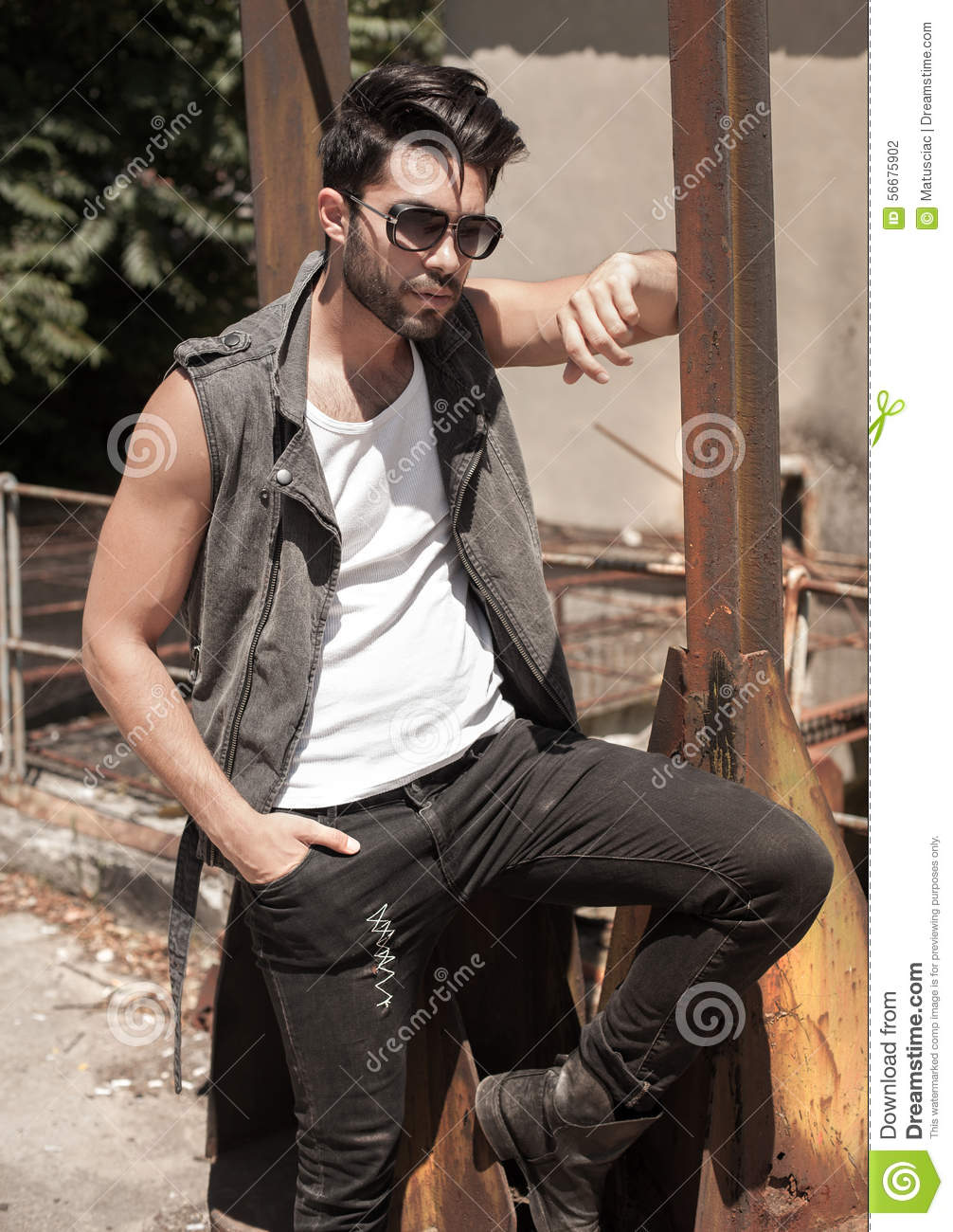 handsome man model dressed punk hipster posing dramatic