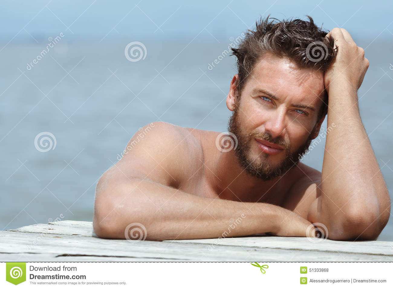 Handsome Man with No Shirt at the Sea