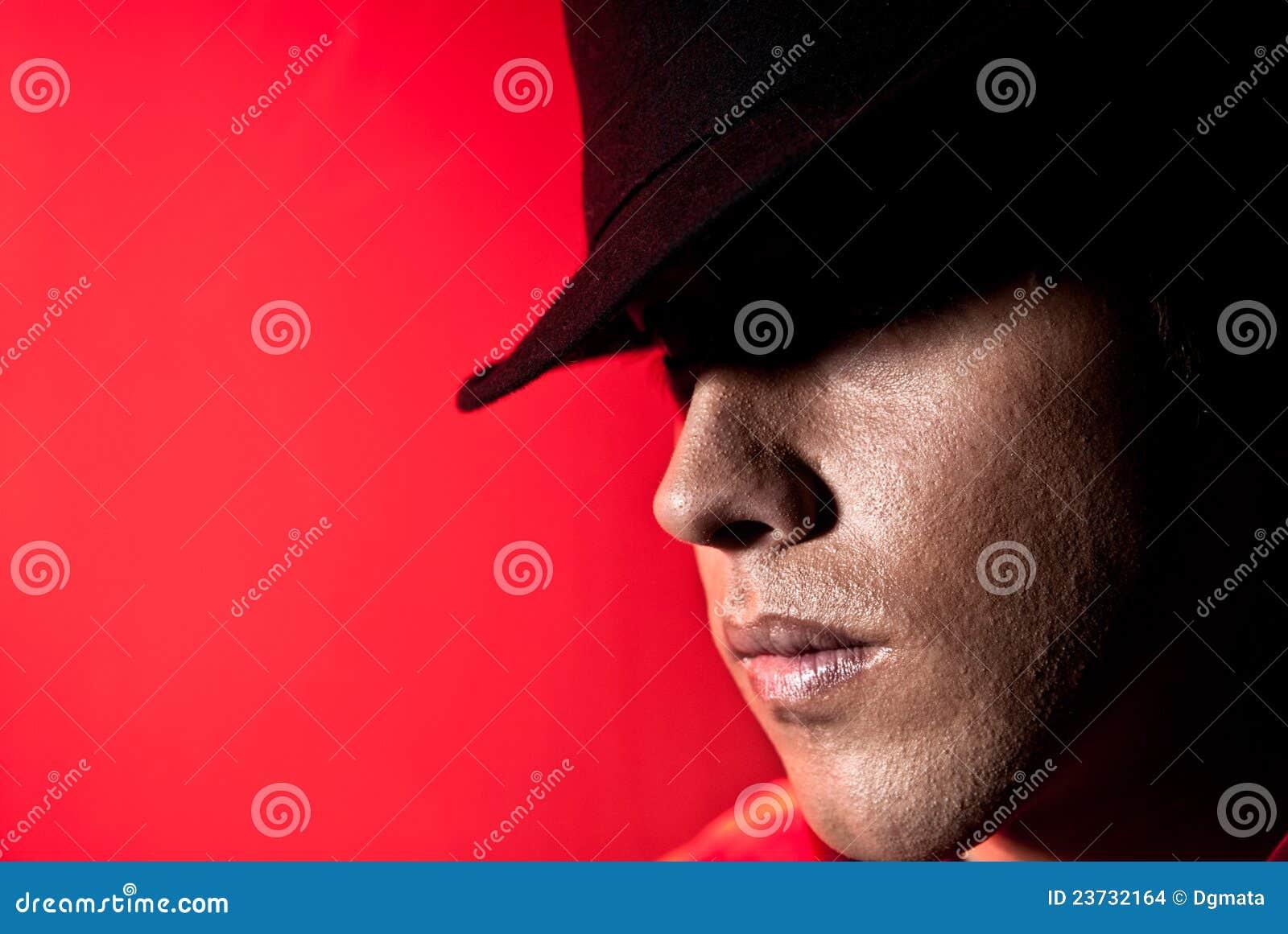 Handsome man portrait hat dark eyes mystery