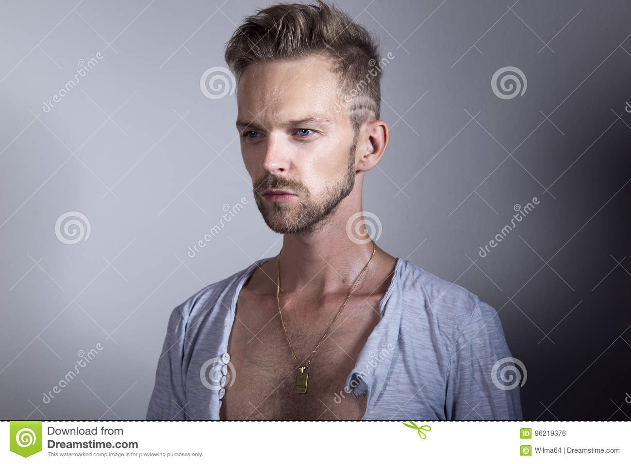 Handsome man with ripped open shirt