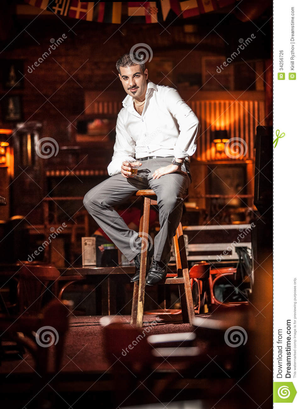 Handsome Man Sitting On Chair On Stage Royalty Free Stock