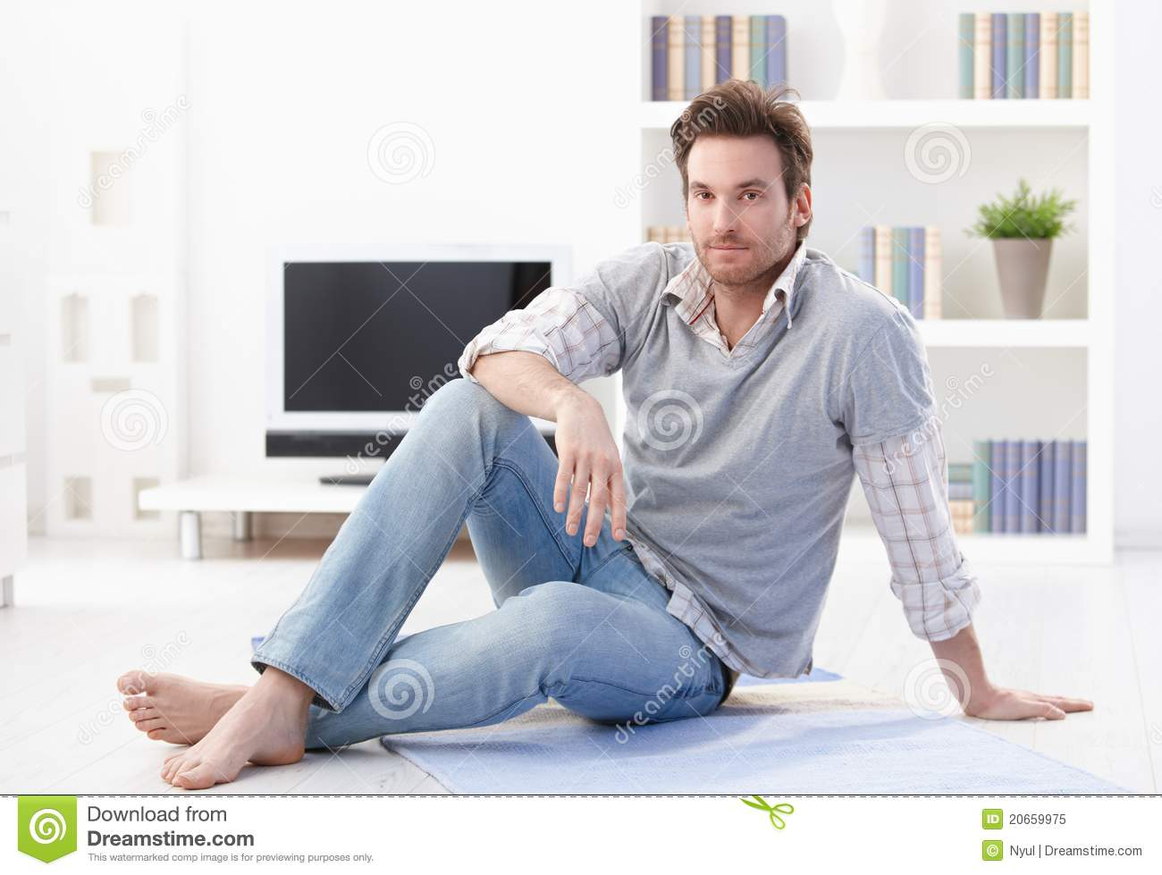 handsome male sitting on floor royalty free stock image. Black Bedroom Furniture Sets. Home Design Ideas