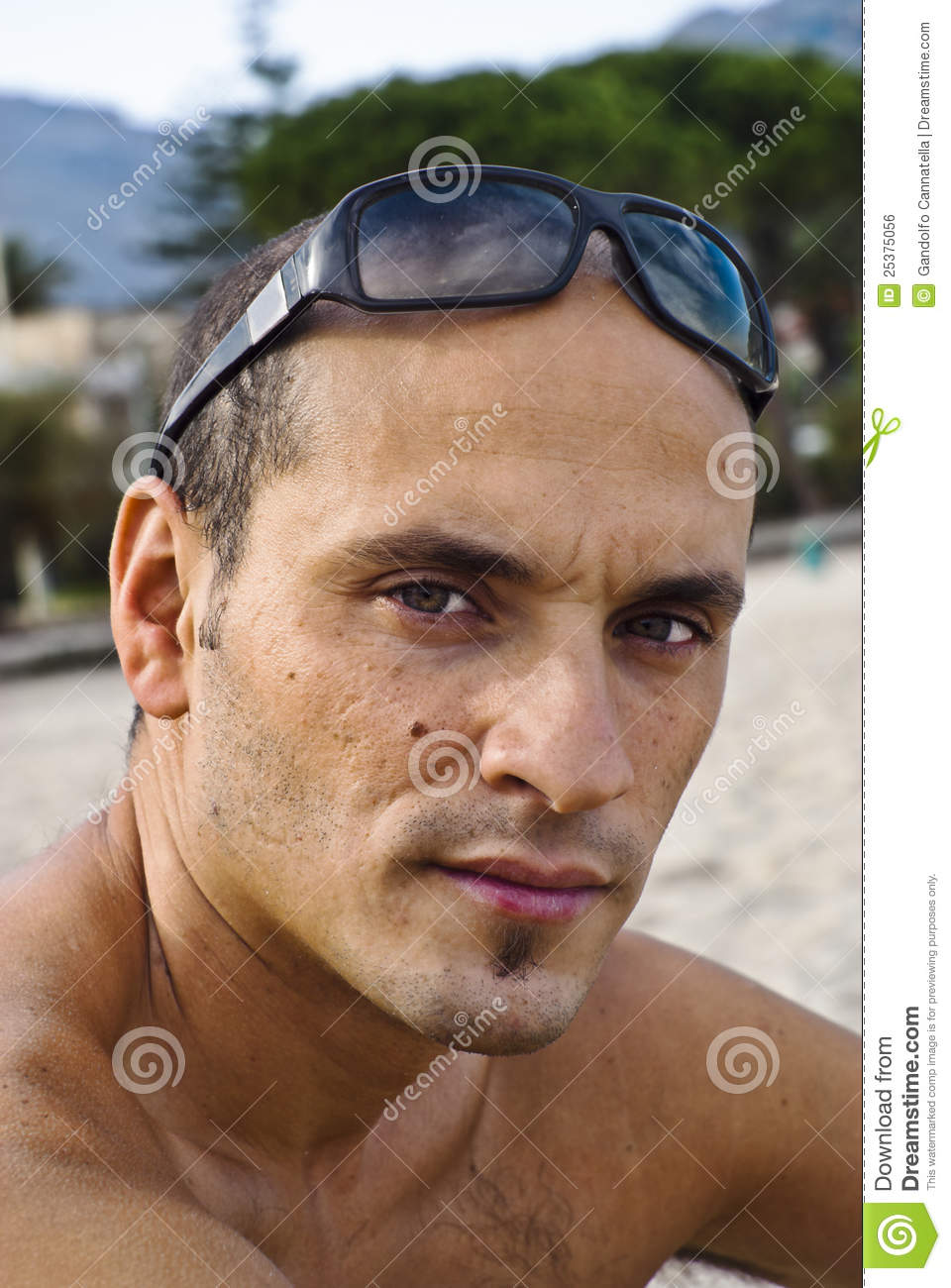 Handsome man with sunglasses on head