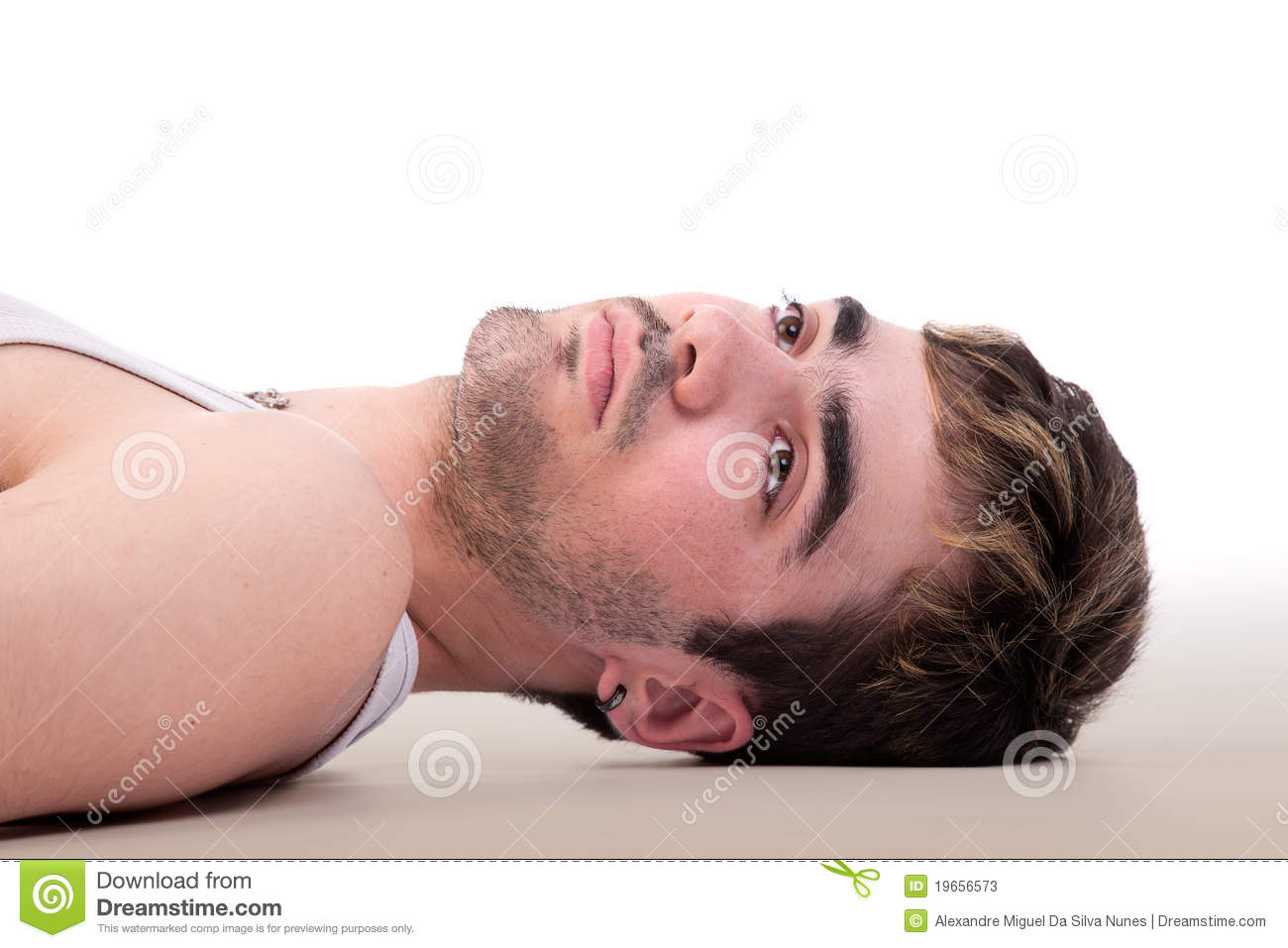 Handsome man thinking lying on floor stock photos image for On the floor