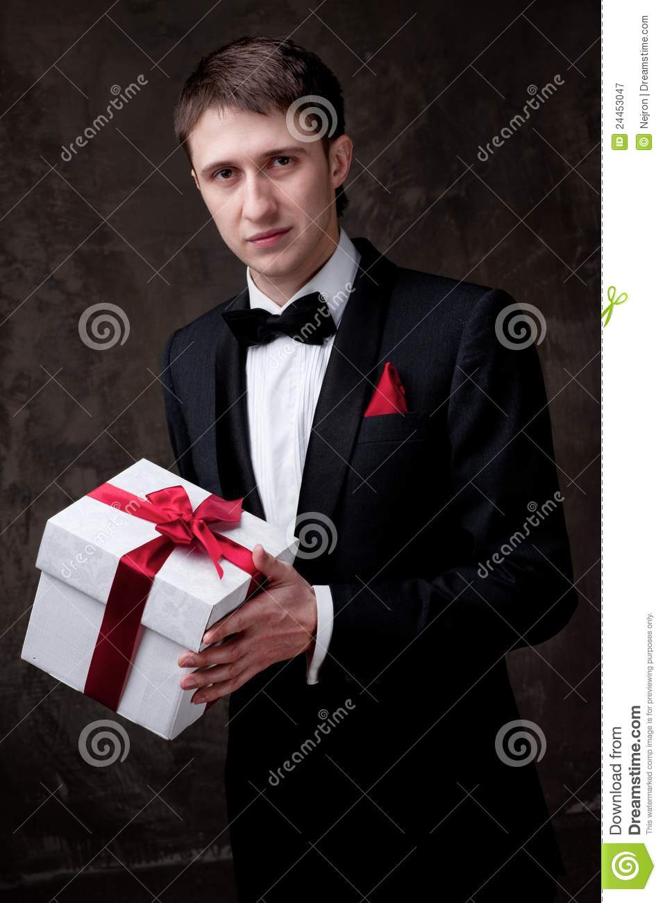 Handsome Man In Tuxedo With A Gift Box Royalty Free Stock ...