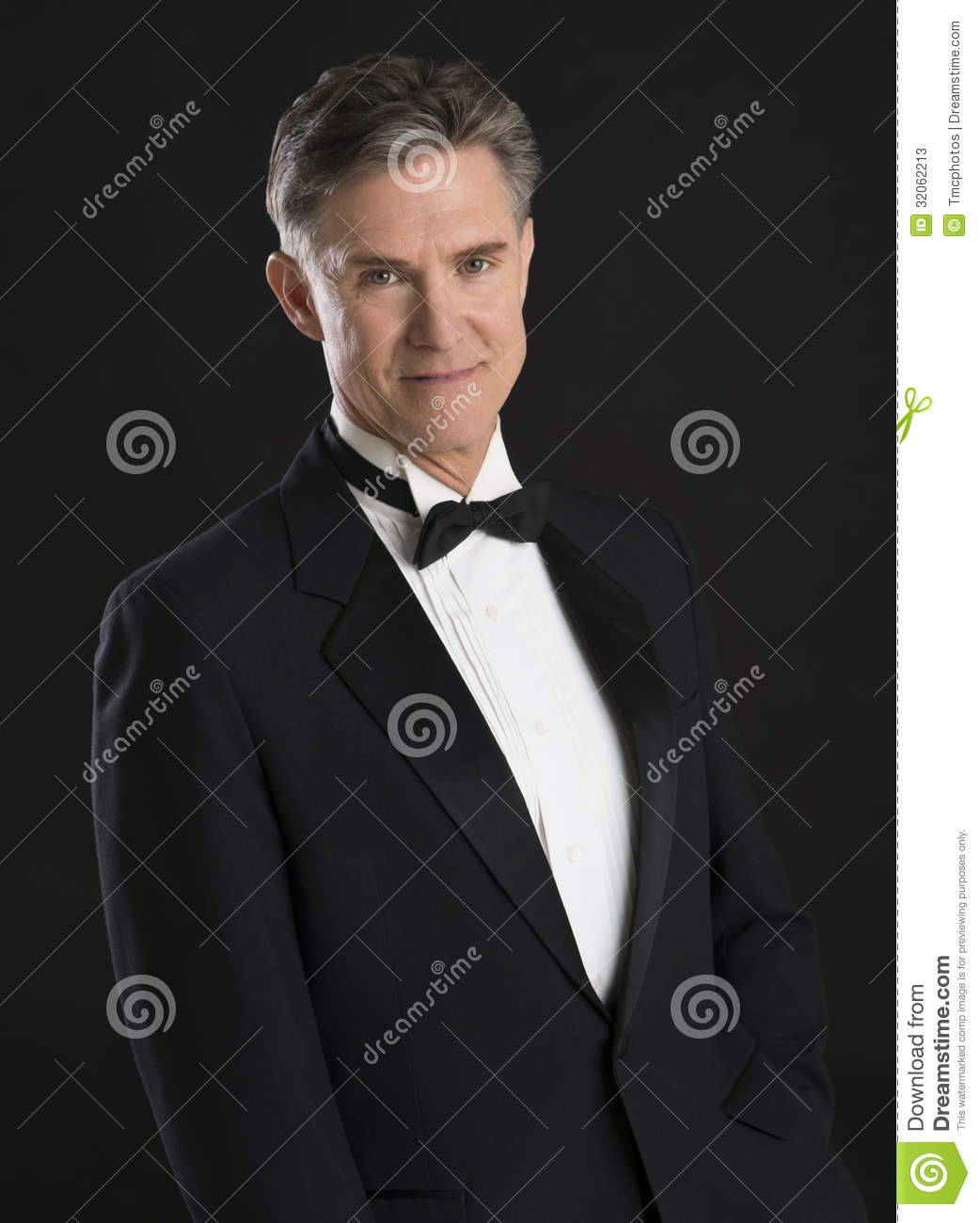 Handsome Man In Tuxedo Standing Against Black Background ...