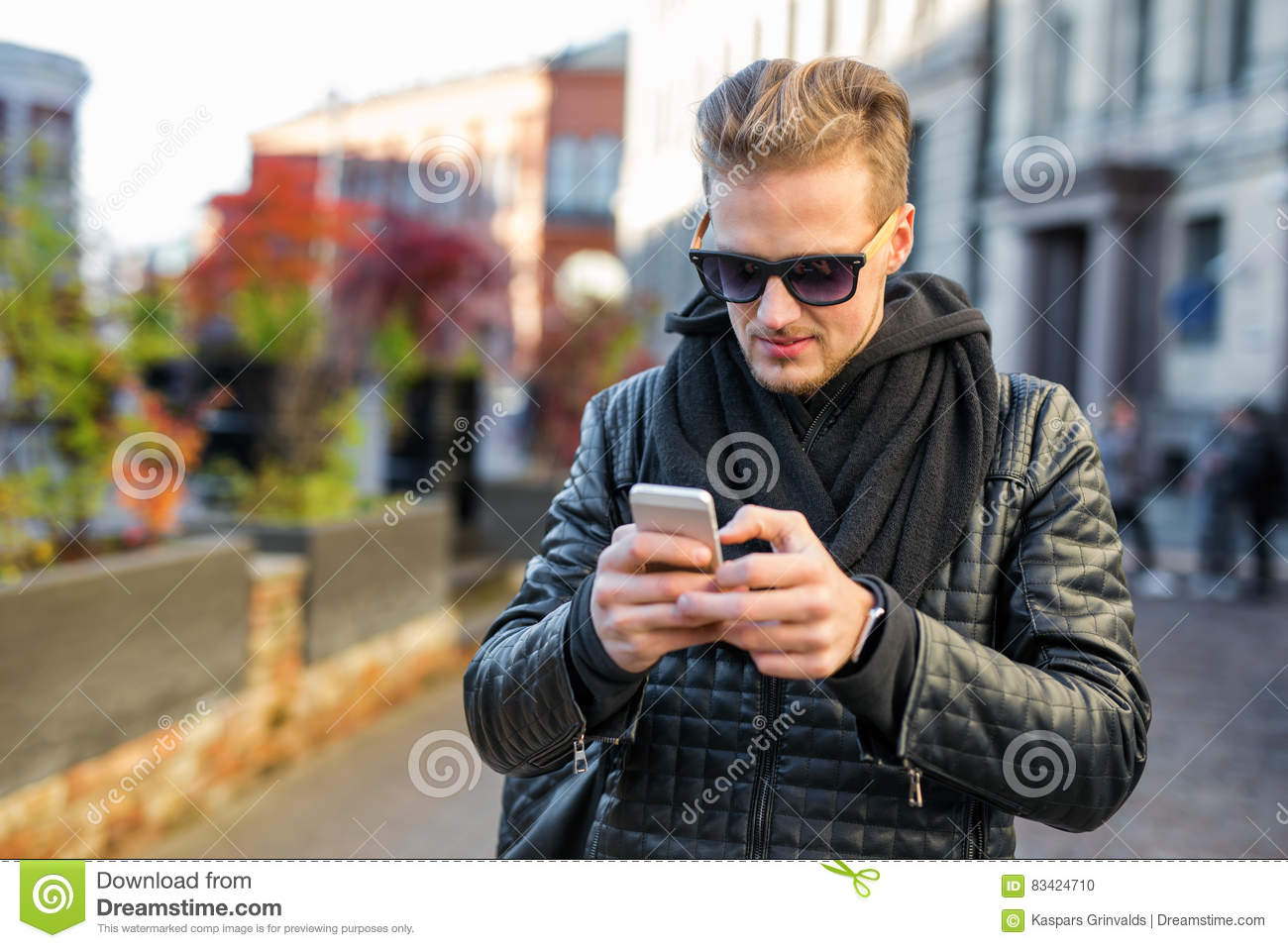 Handsome man using his smartphone