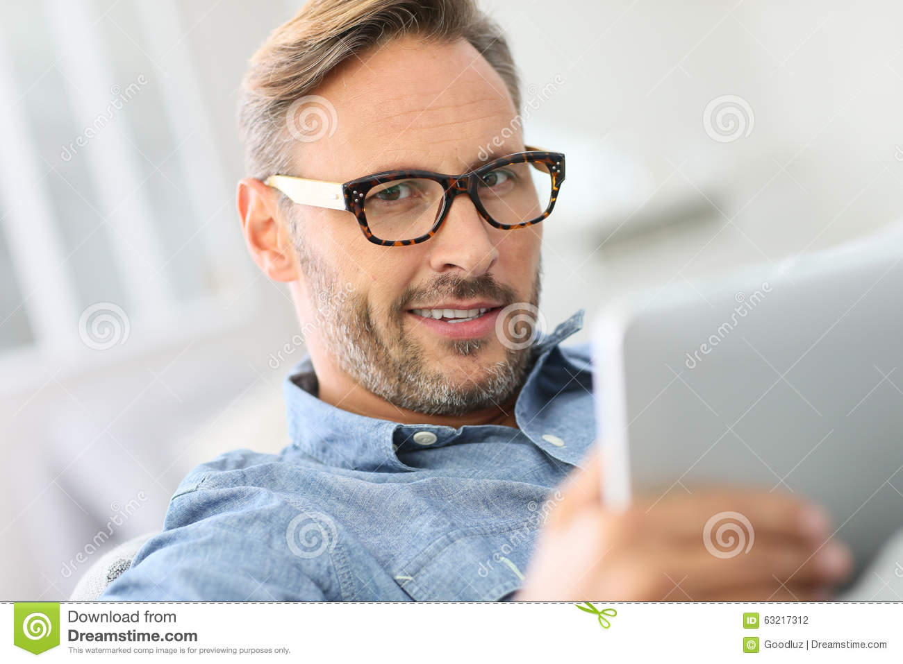 b523663cc4a Handsome Man Wearing Eyeglasses And Websurfing Stock Photo - Image ...