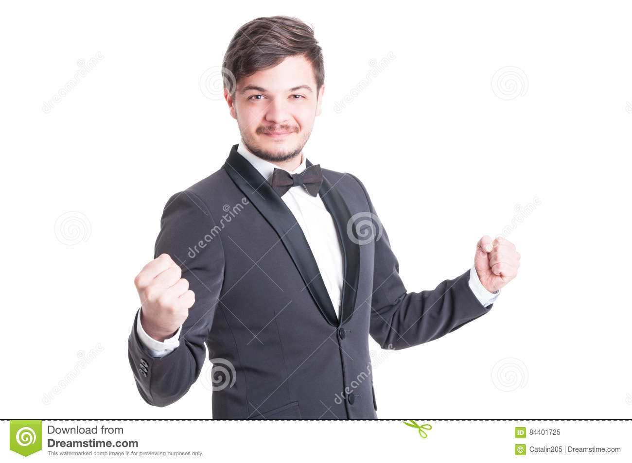 Handsome man wearing tuxedo and bowtie making success gesture