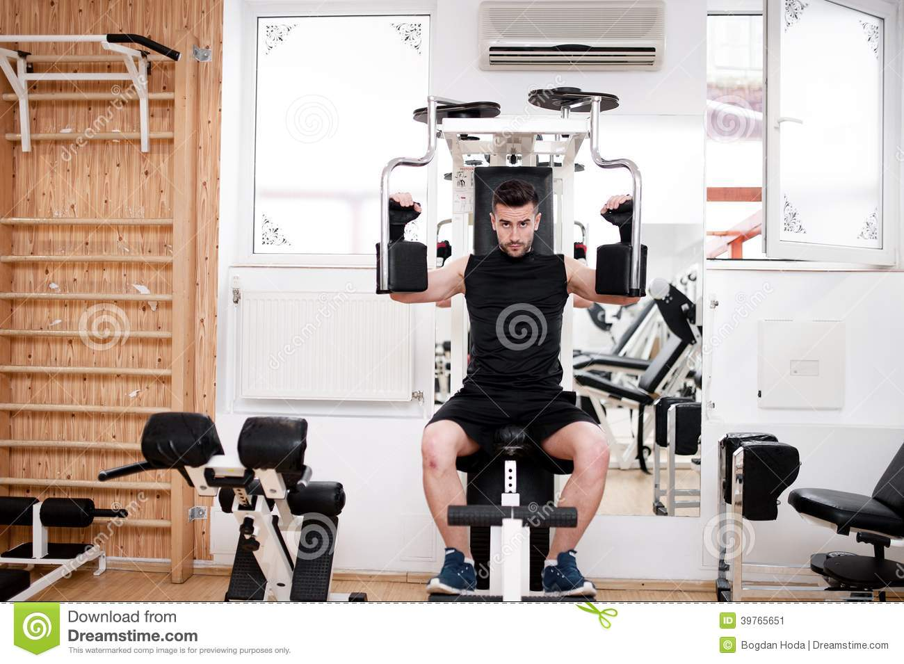 Download Handsome Man Working Out At Gym Daily Chest Exercise Routine Stock Image
