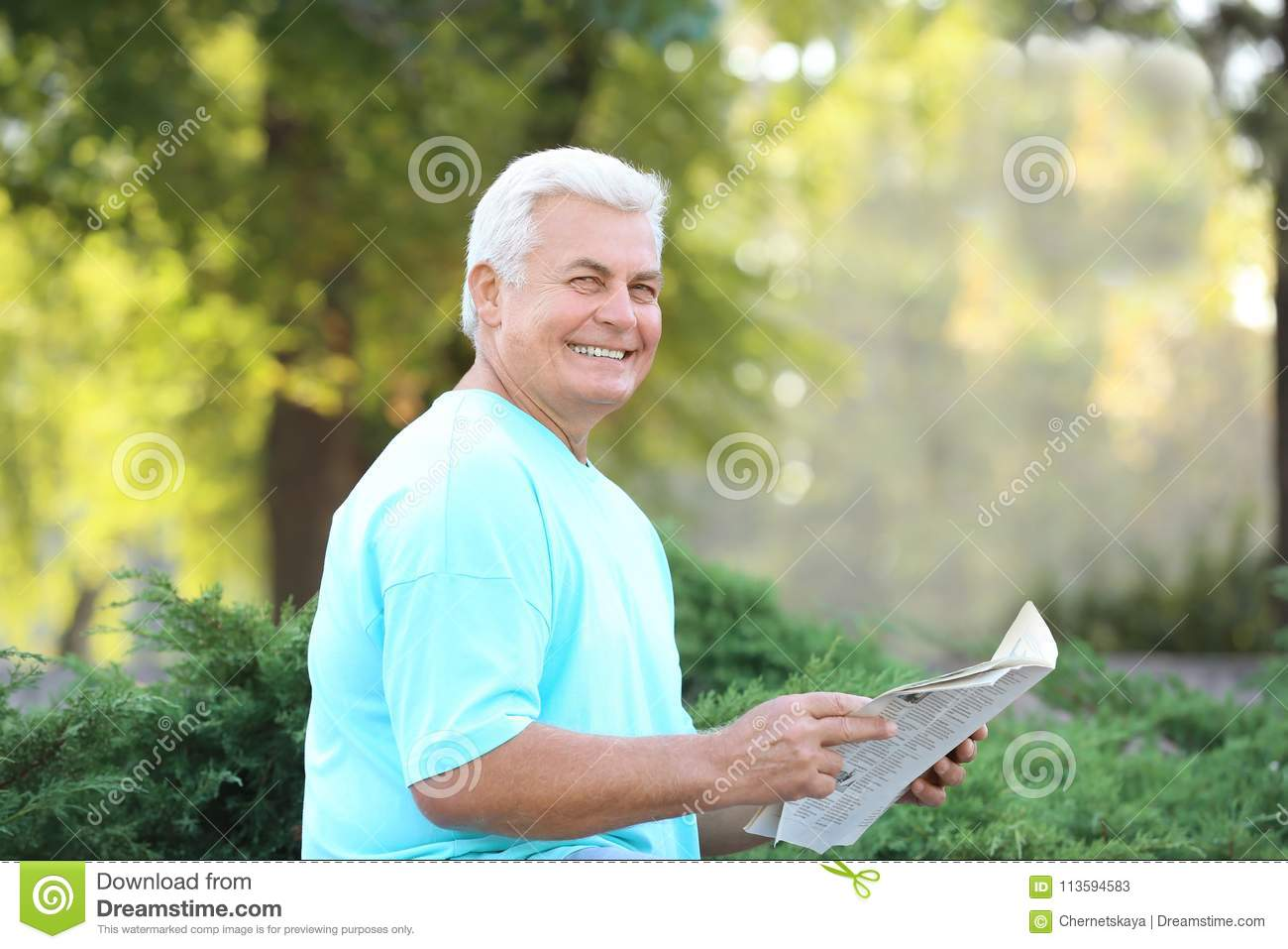 Handsome mature man with newspaper