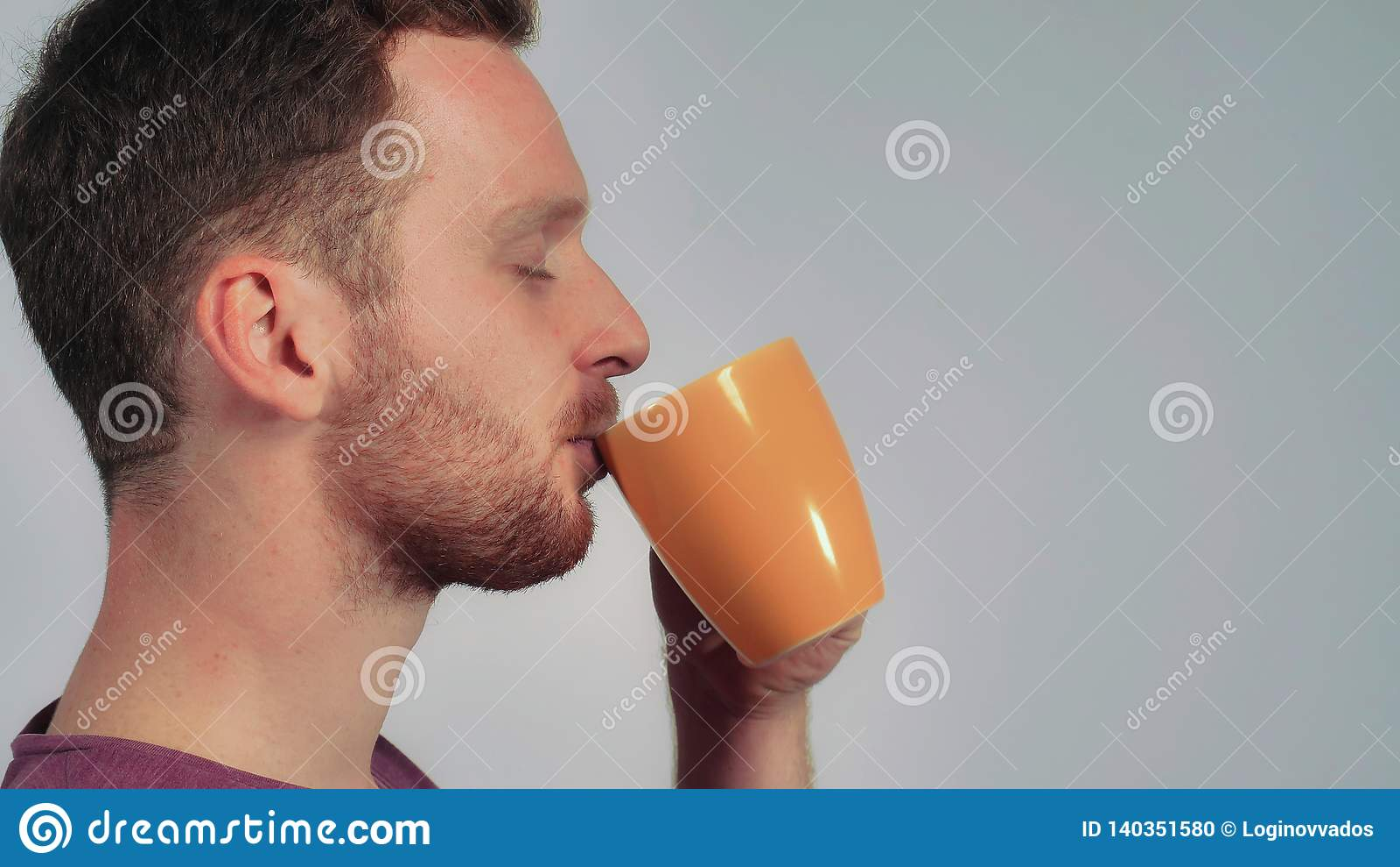 Handsome men relish mug with tea
