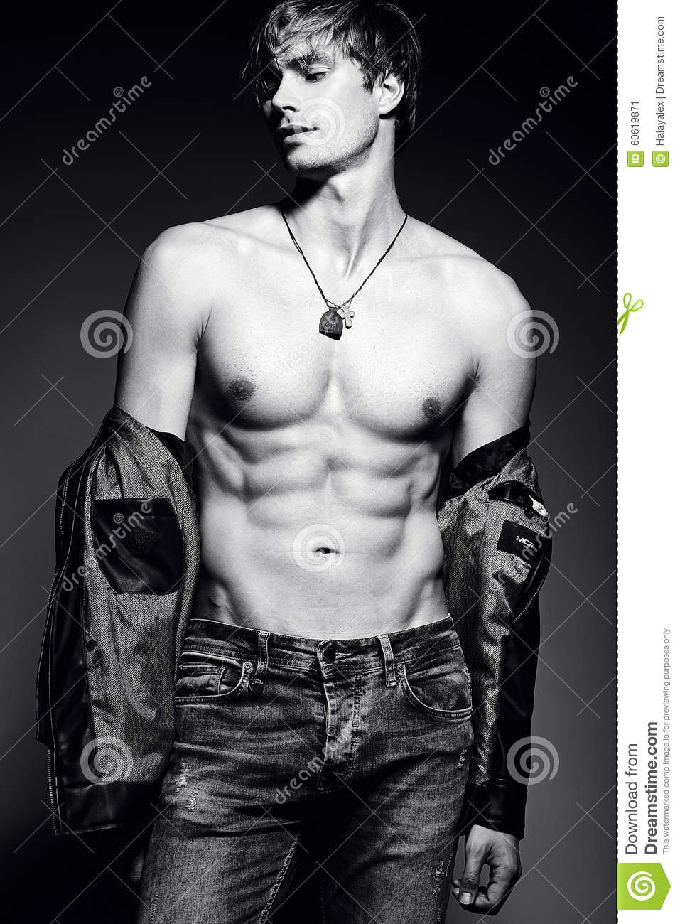 handsome muscled fit male model man posing in studio showing his abdominal muscles