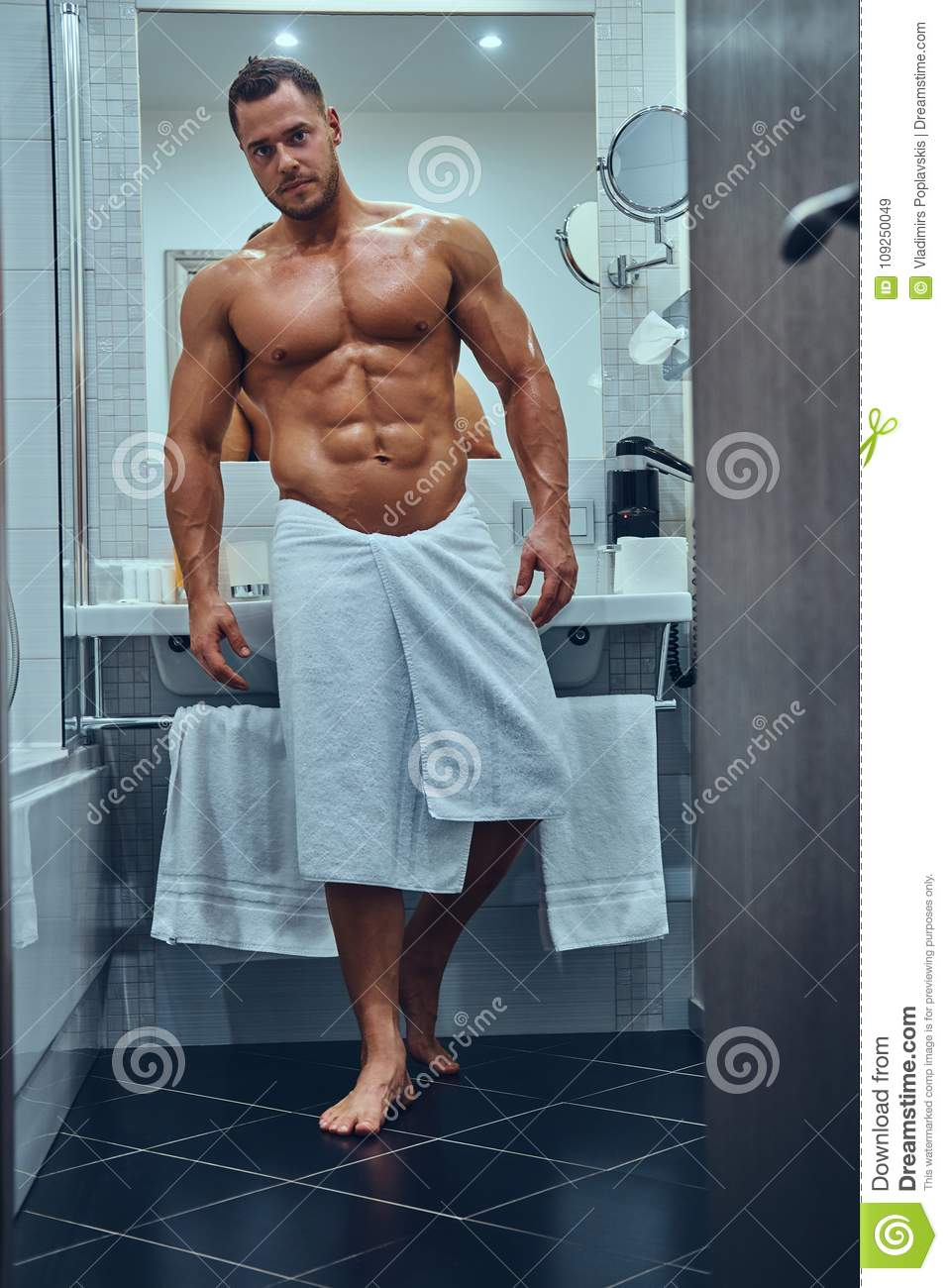 A Handsome Muscular Male In Stylish Twin Bathroom. Stock Image ... 319c5f957