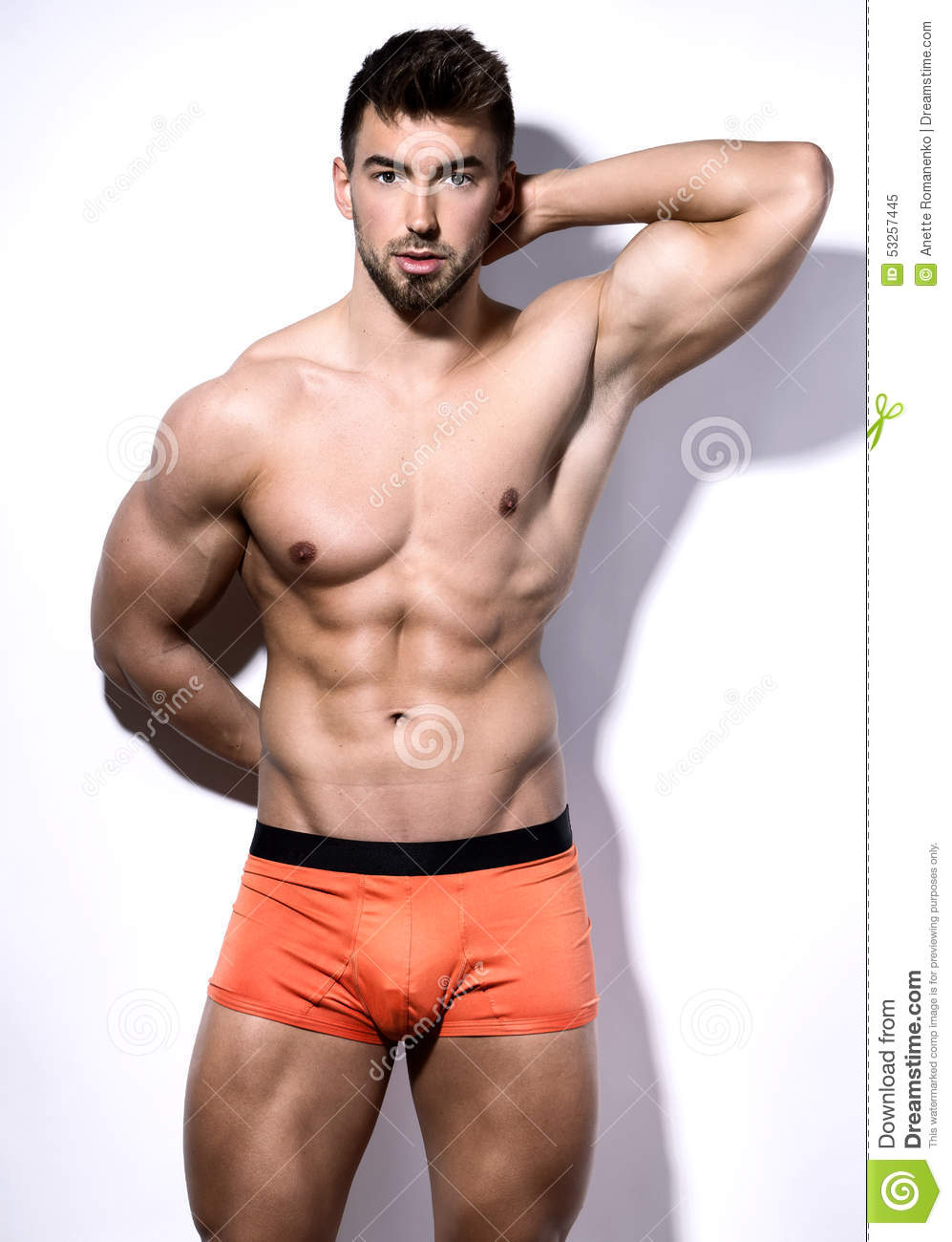 Handsome Muscular Young Bodybuilder Showing His Muscles
