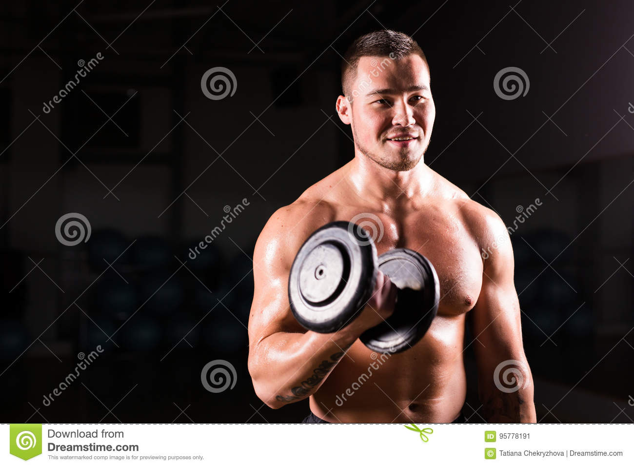 Muscular Man Exercising With Dumbbells Stock Photo - Image