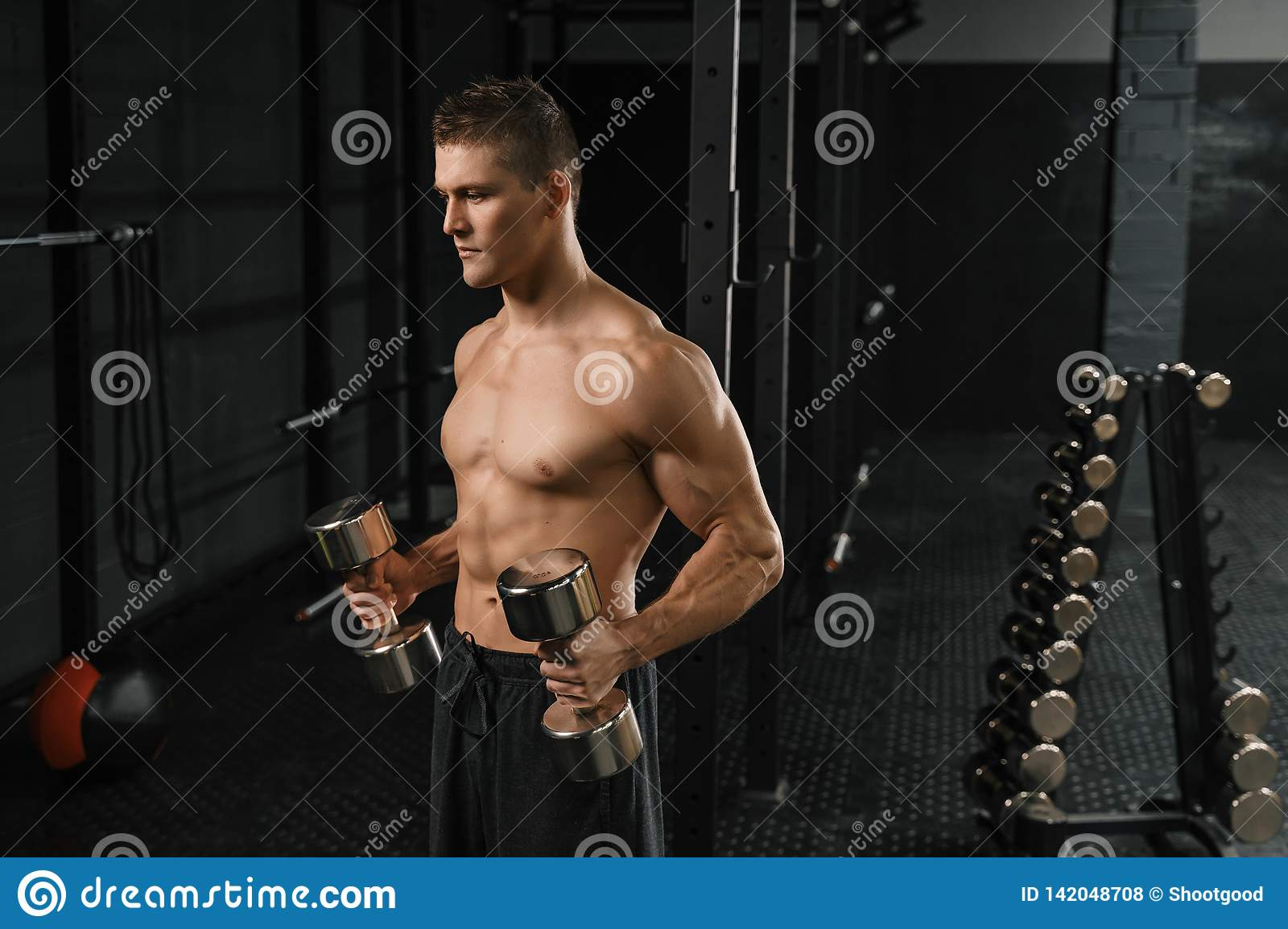 Handsome Power Athletic Man Bodybuilder Doing Exercises With