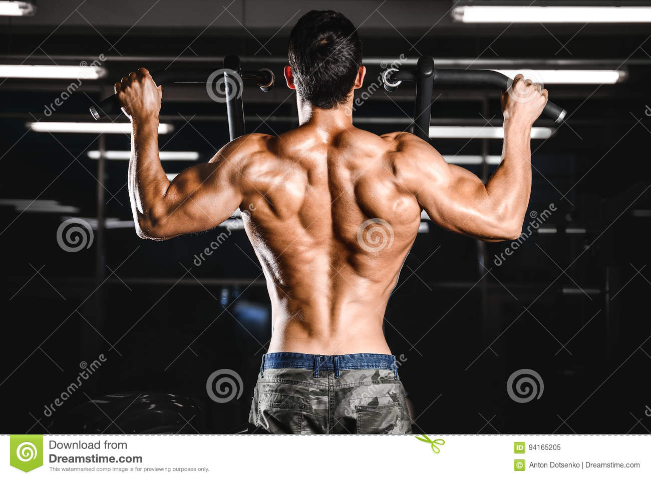 Handsome Power Athletic Man Diet Training Pumping Up Back Muscle
