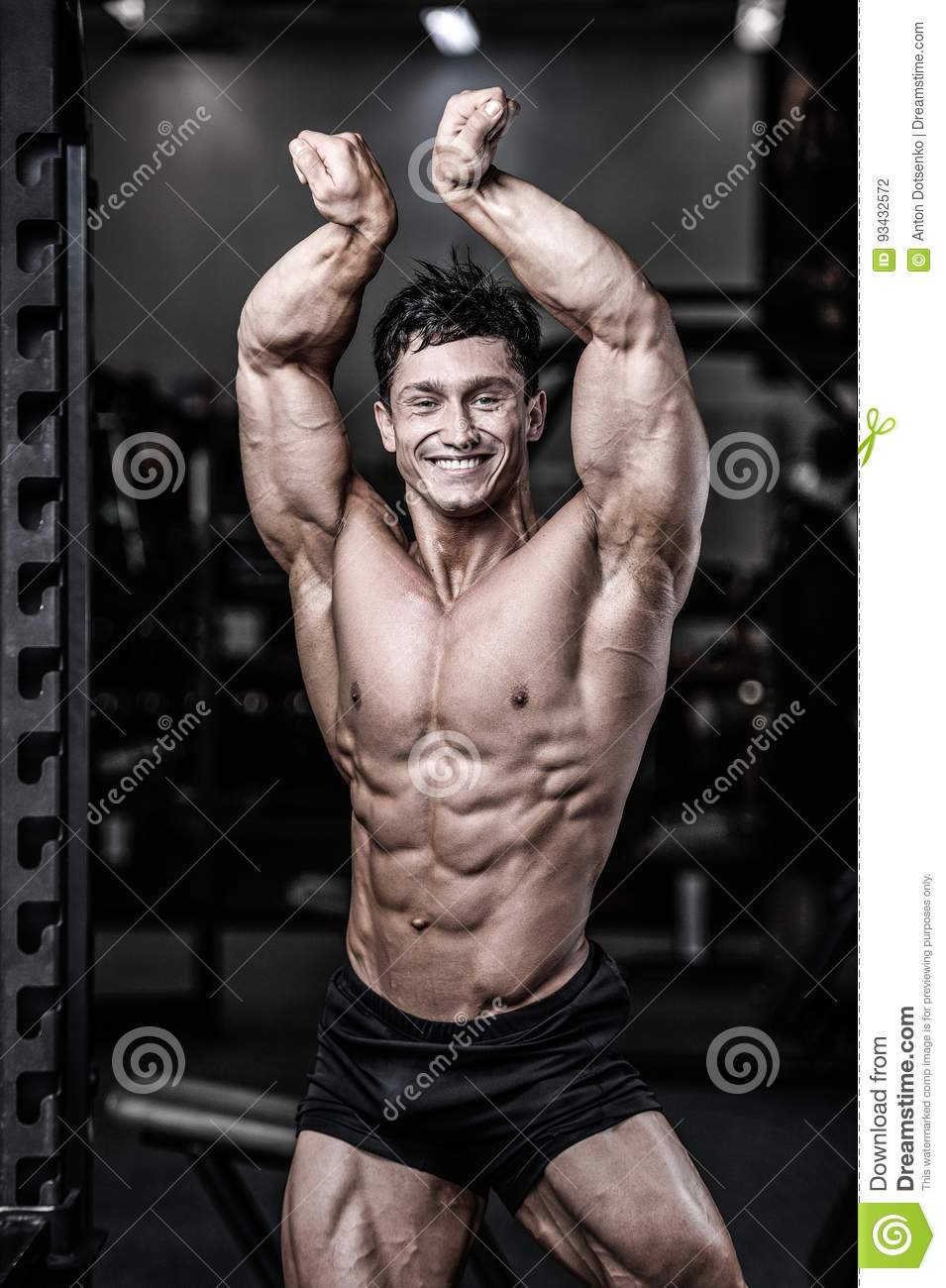 Muscular Man Working Out Doing Exercises With Barbell