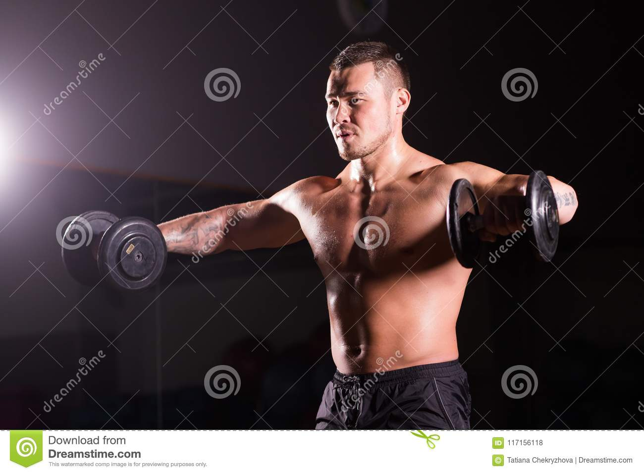Handsome Power Athletic Man With Dumbbell  Strong