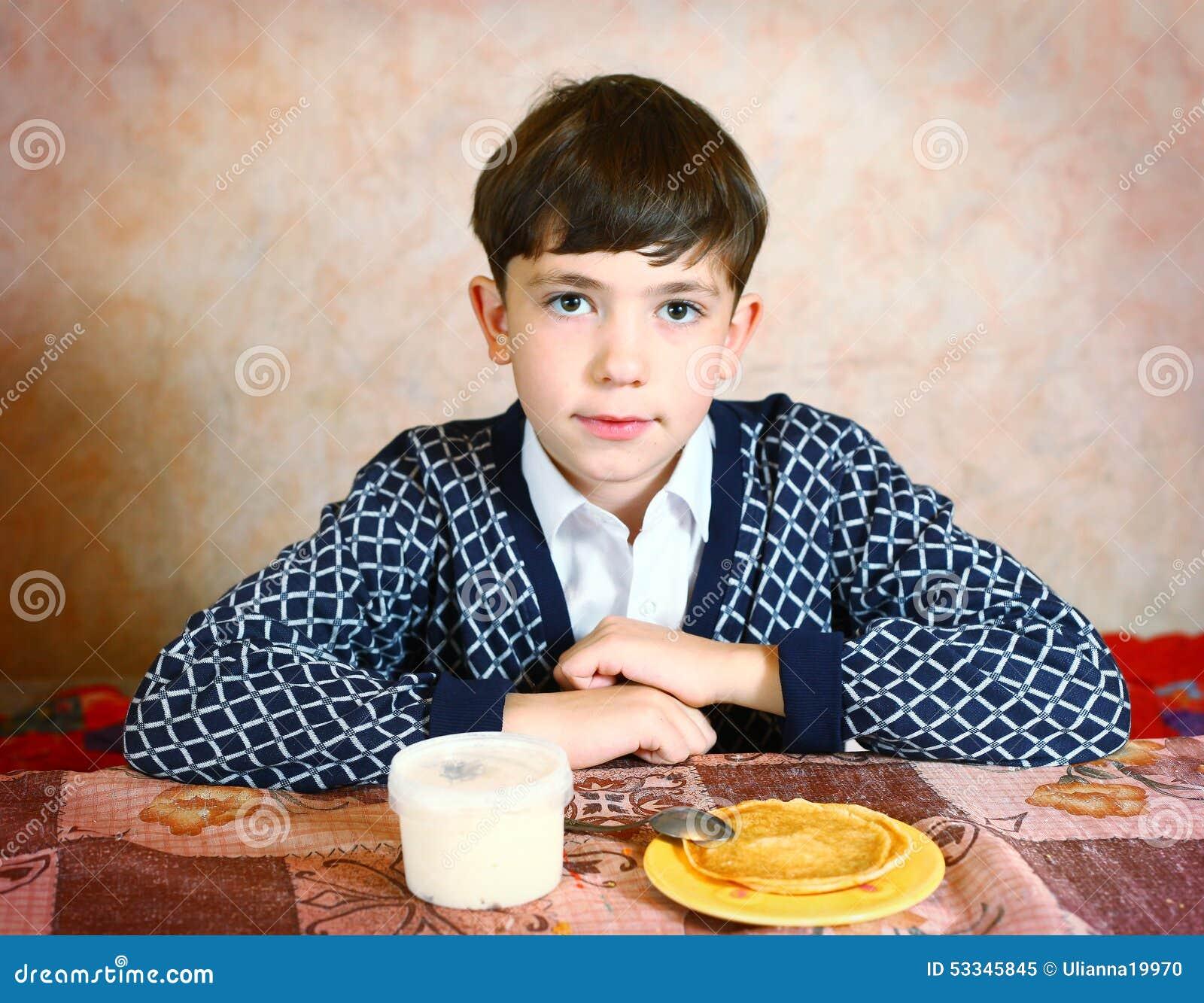 Stock Photo: Handsome preteen boy expressive close black and white ...