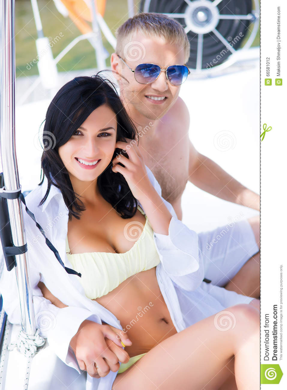 228fe85408 Handsome And Rich Man And A Beautiful And Woman In A Swimsuit Stock ...