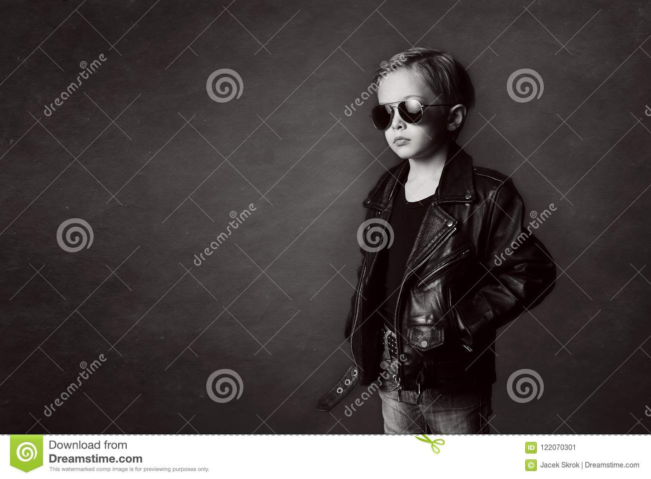 A Handsome Sad Boy In Leather Jacket And Jeans On A Black