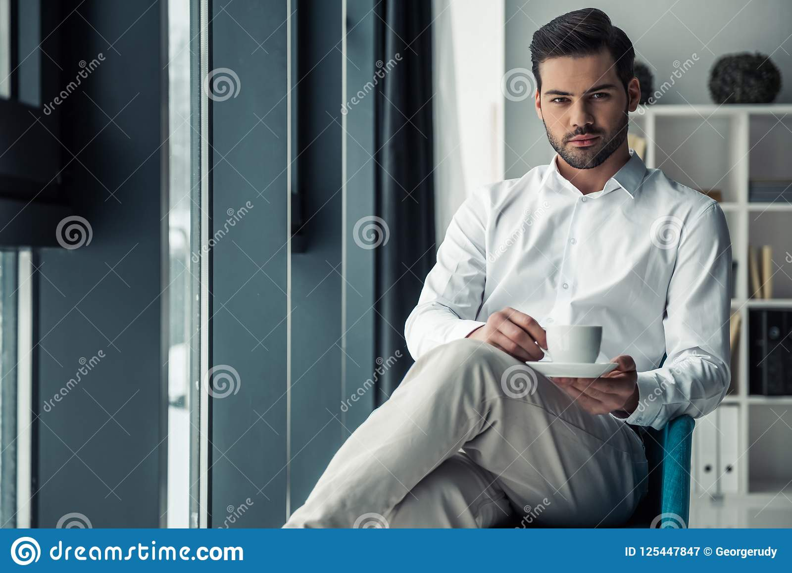 Download Handsome Businessman In Office Stock Image - Image of person, handsome: 125447847