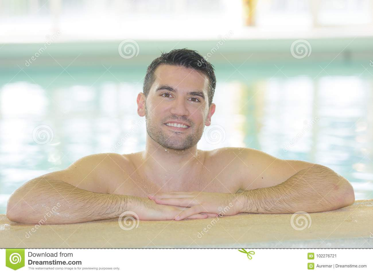 Handsome man in swimming pool