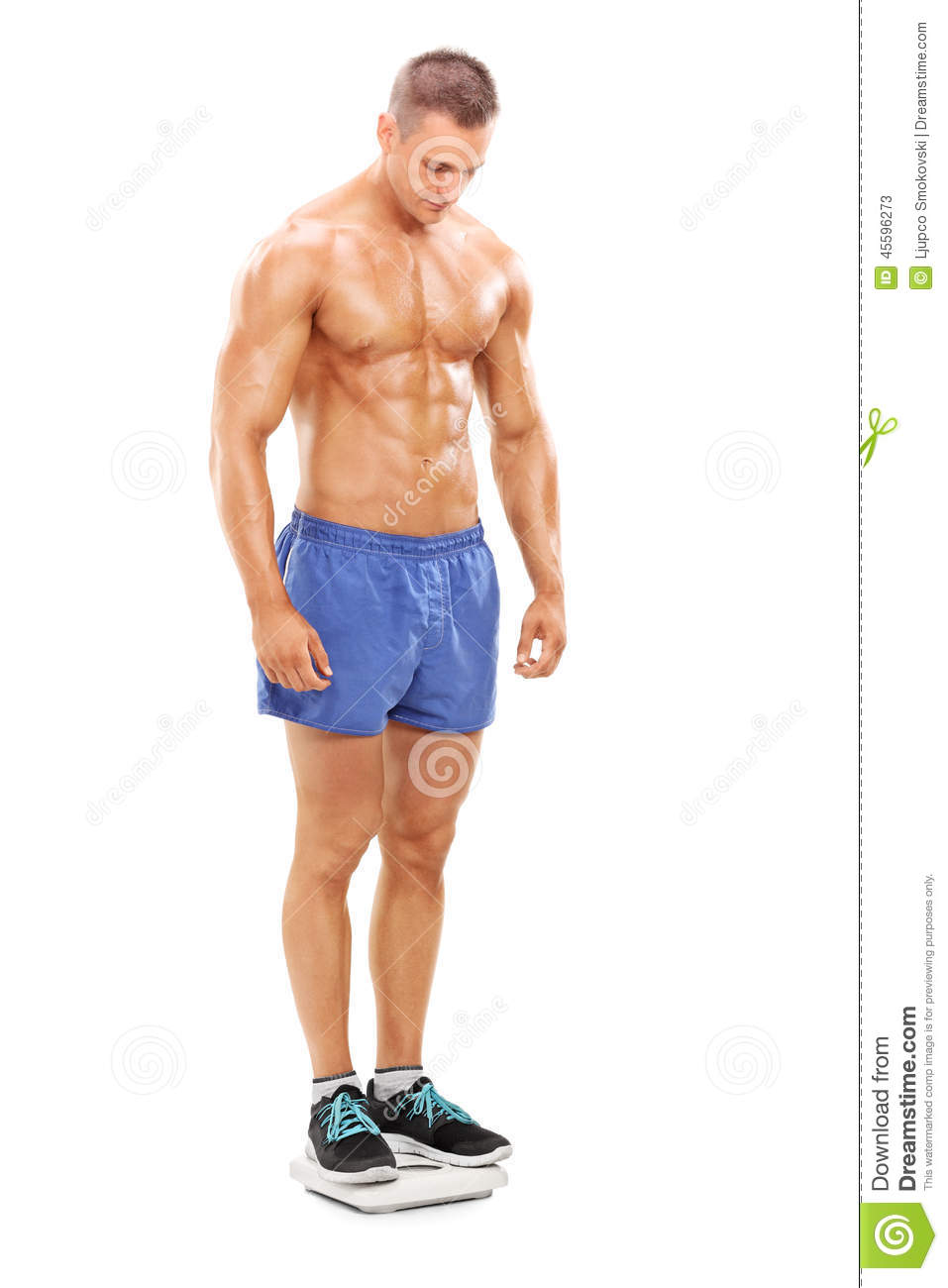 Handsome shirtless man standing on a weight scale