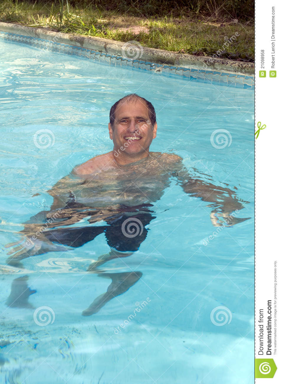 Handsome smiling middle age man swimming in pool royalty for Pool man show
