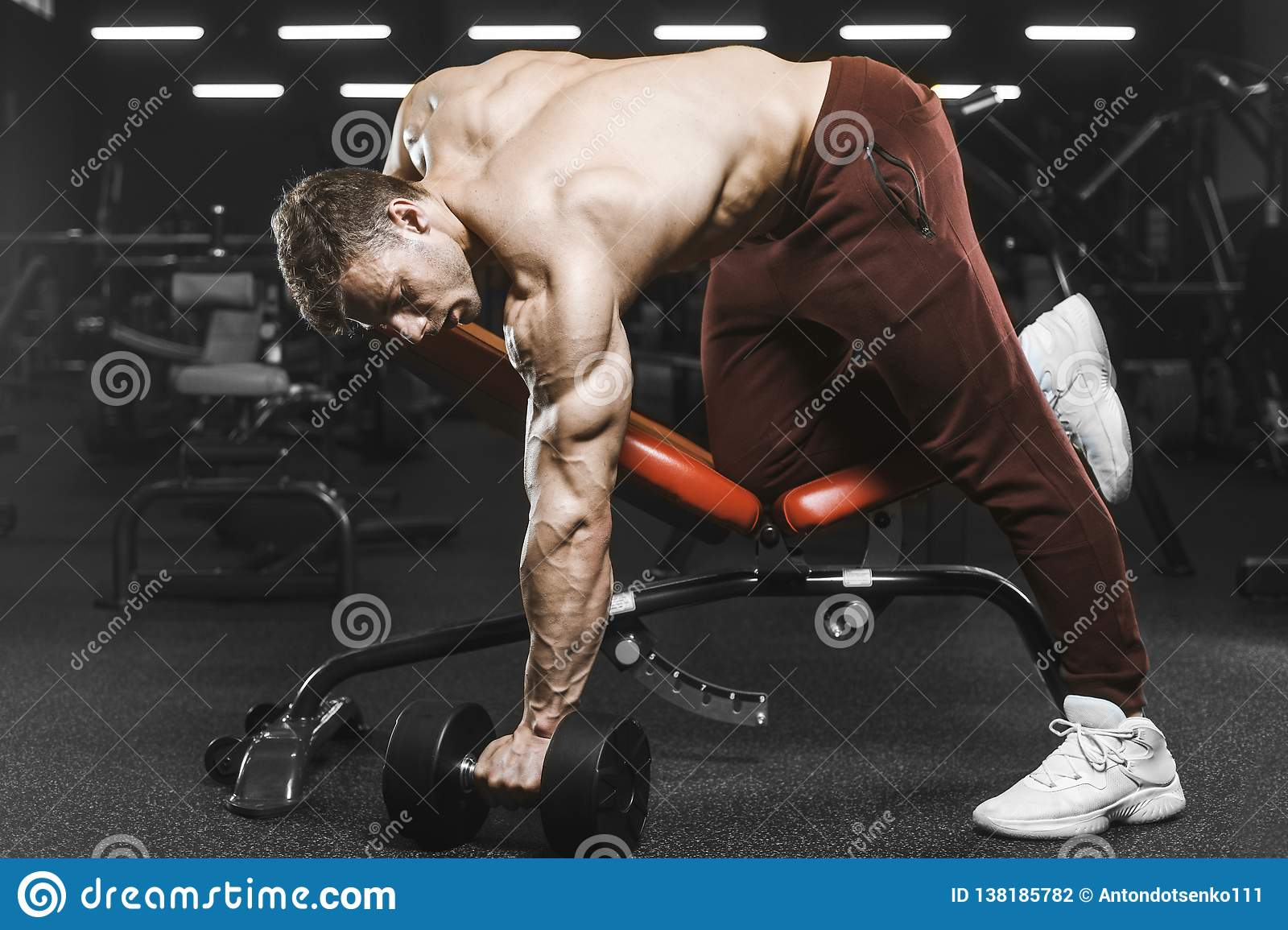 ce5ab2b6e70 Handsome strong athletic man pumping up muscles workout barbell curl bodybuilding  concept background - muscular bodybuilder man doing exercises in gym naked  ...