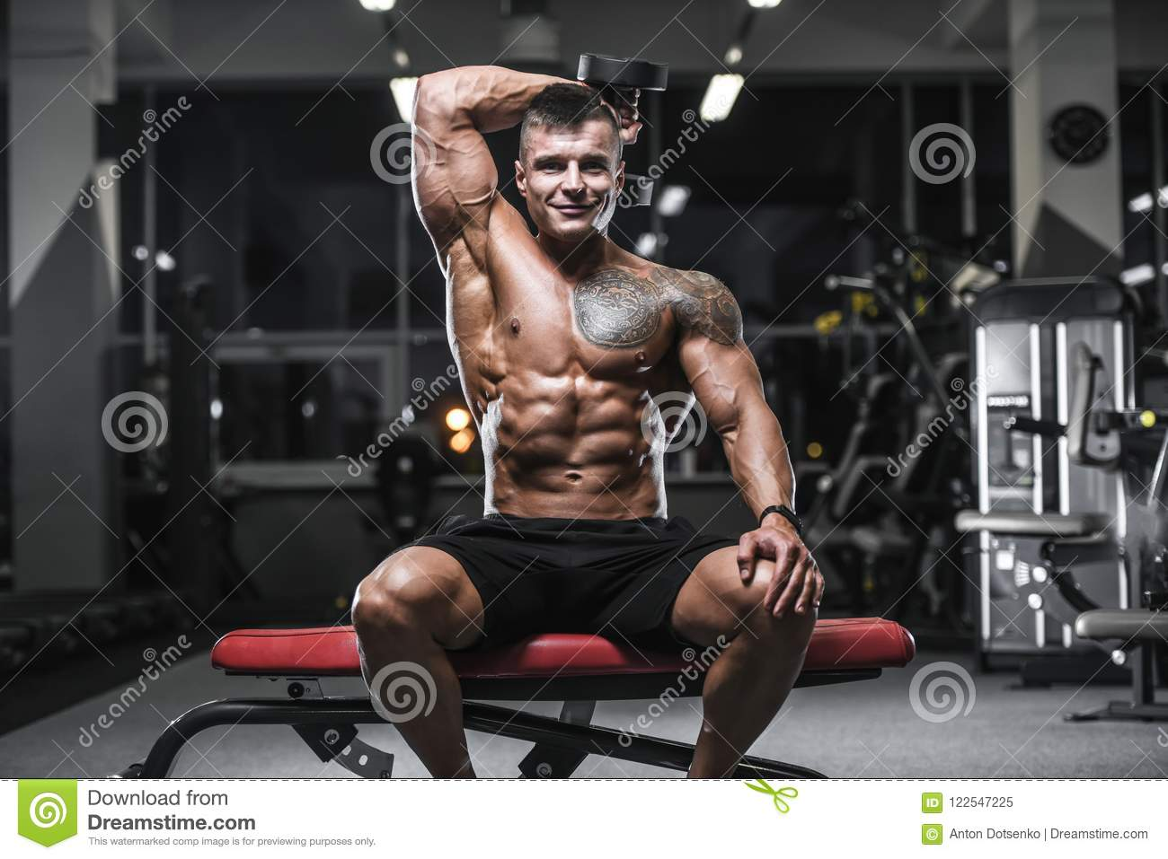 893e2173113 Handsome strong bodybuilder athletic man pumping up muscles workout  bodybuilding concept background - muscular bodybuilder handsome man doing  exercises in ...