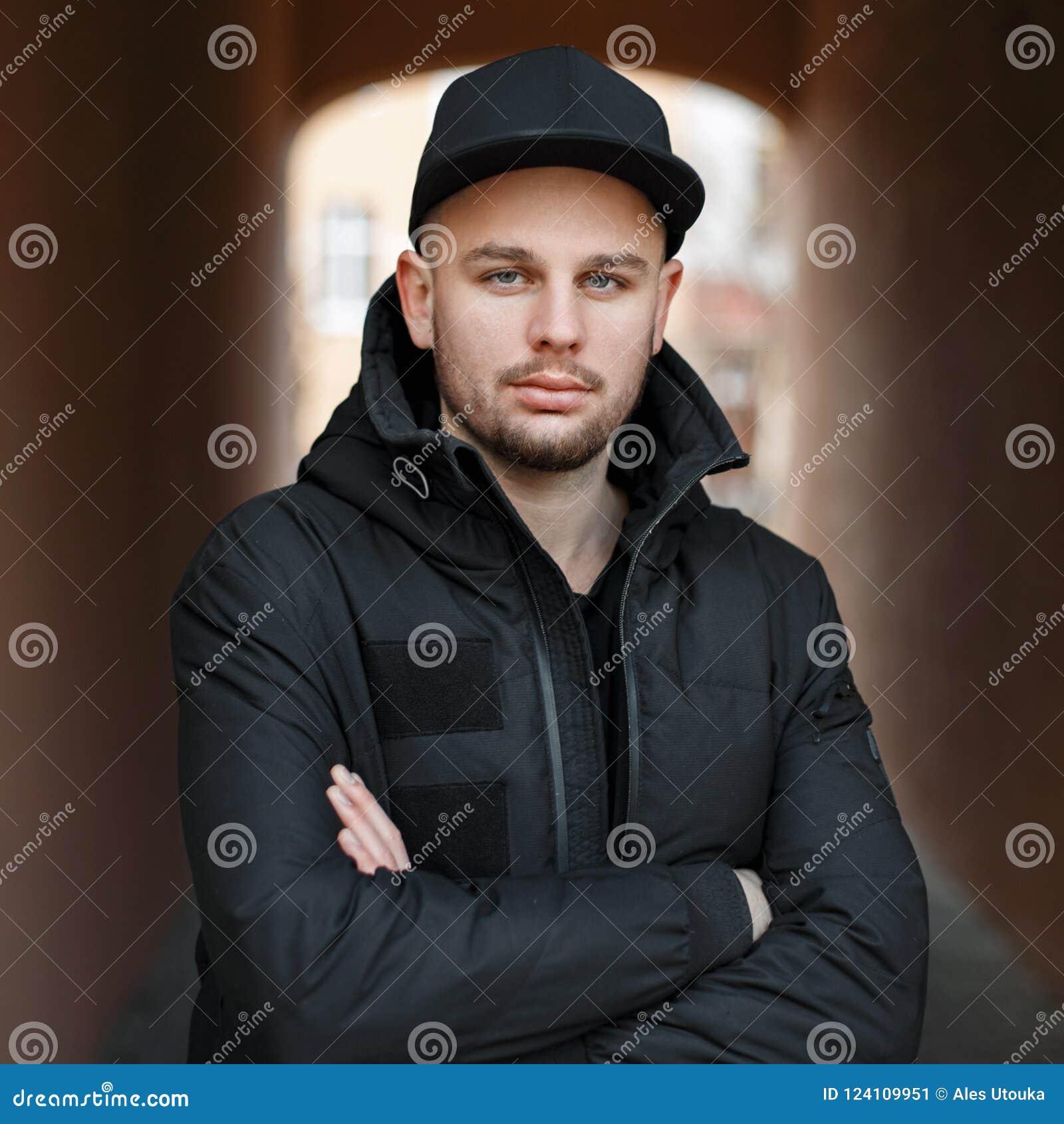 b3fde1dcfa2 Handsome Stylish Man In A Black Baseball Cap And Winter Jacket Stock ...