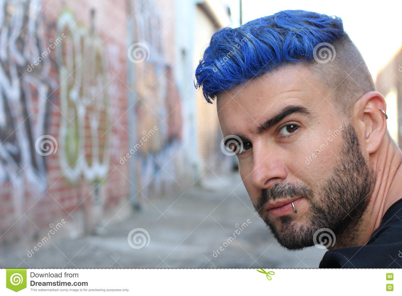 Handsome Stylish Young Man With Artificially Coloured Blue