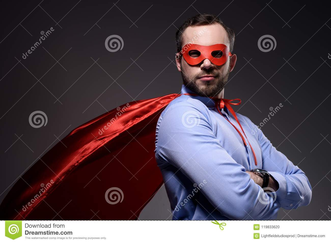handsome super businessman in mask and cape with crossed arms looking at camera
