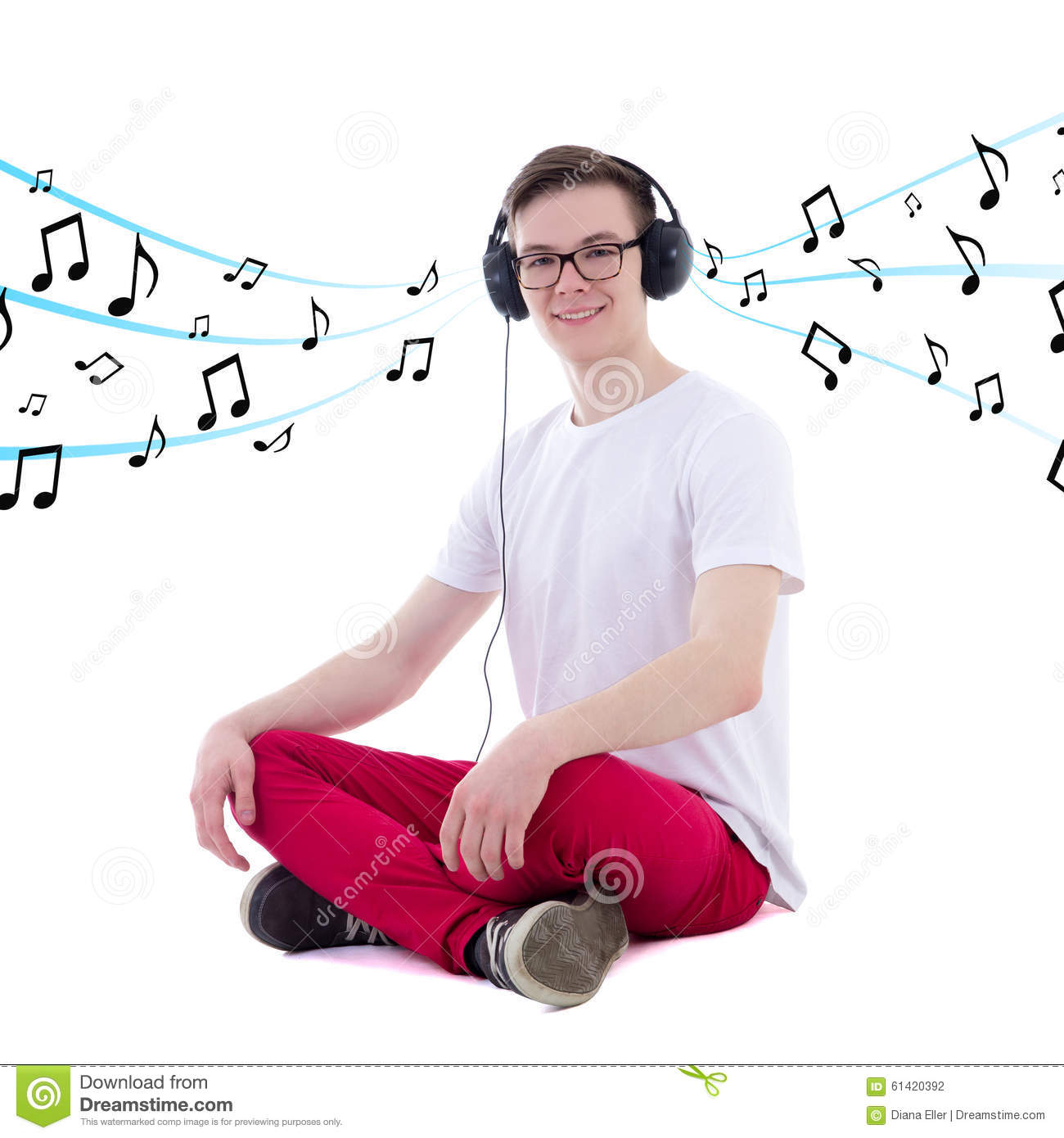 Handsome teenage boy in headphones listening music isolated on w