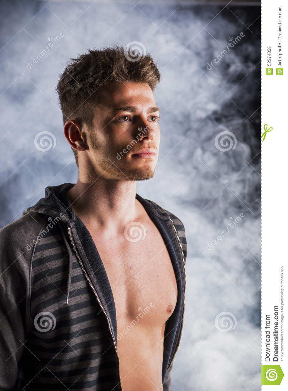 15 Year Boys Bedroom: Handsome Tough Young Man In Dark Hoodie On Smoky Stock