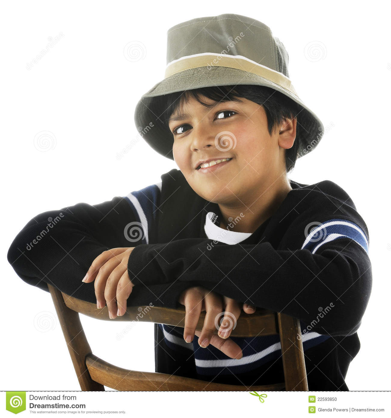 A happy biracial preteen sitting backwards on a ladder-back chair while  wearing a bucket hat. On a white background. 91f2c6f89e7