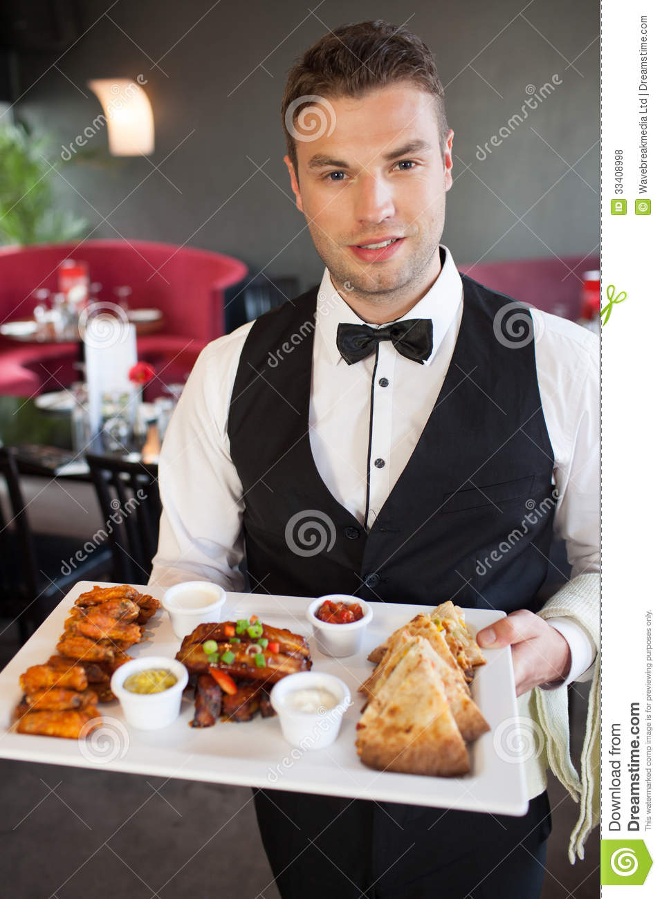 Handsome Waiter Serving Appetizing Finger Food Platter ...