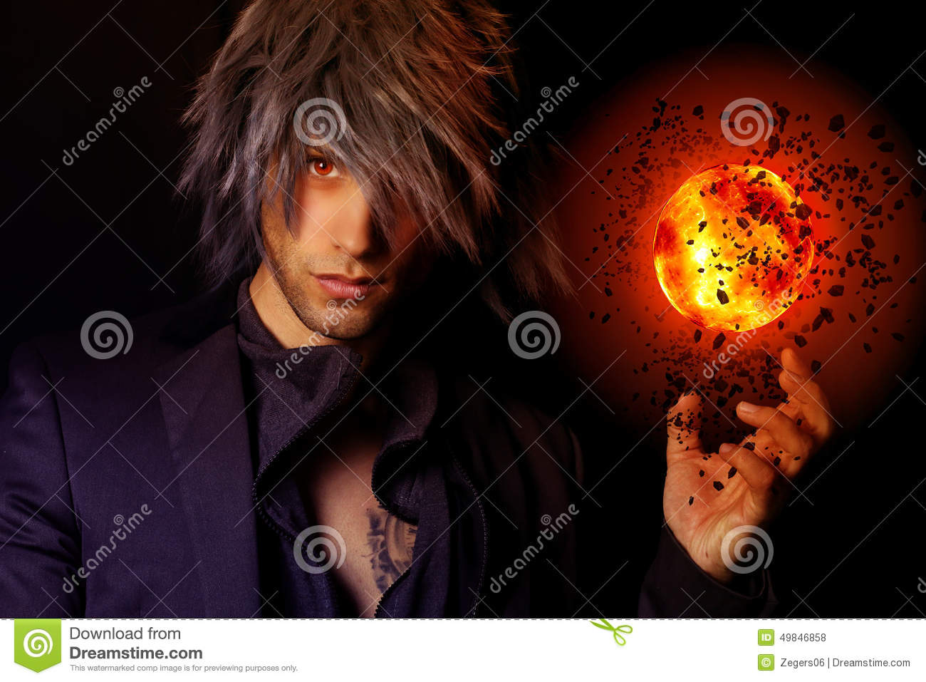 handsome wizard with a fireball stock photo