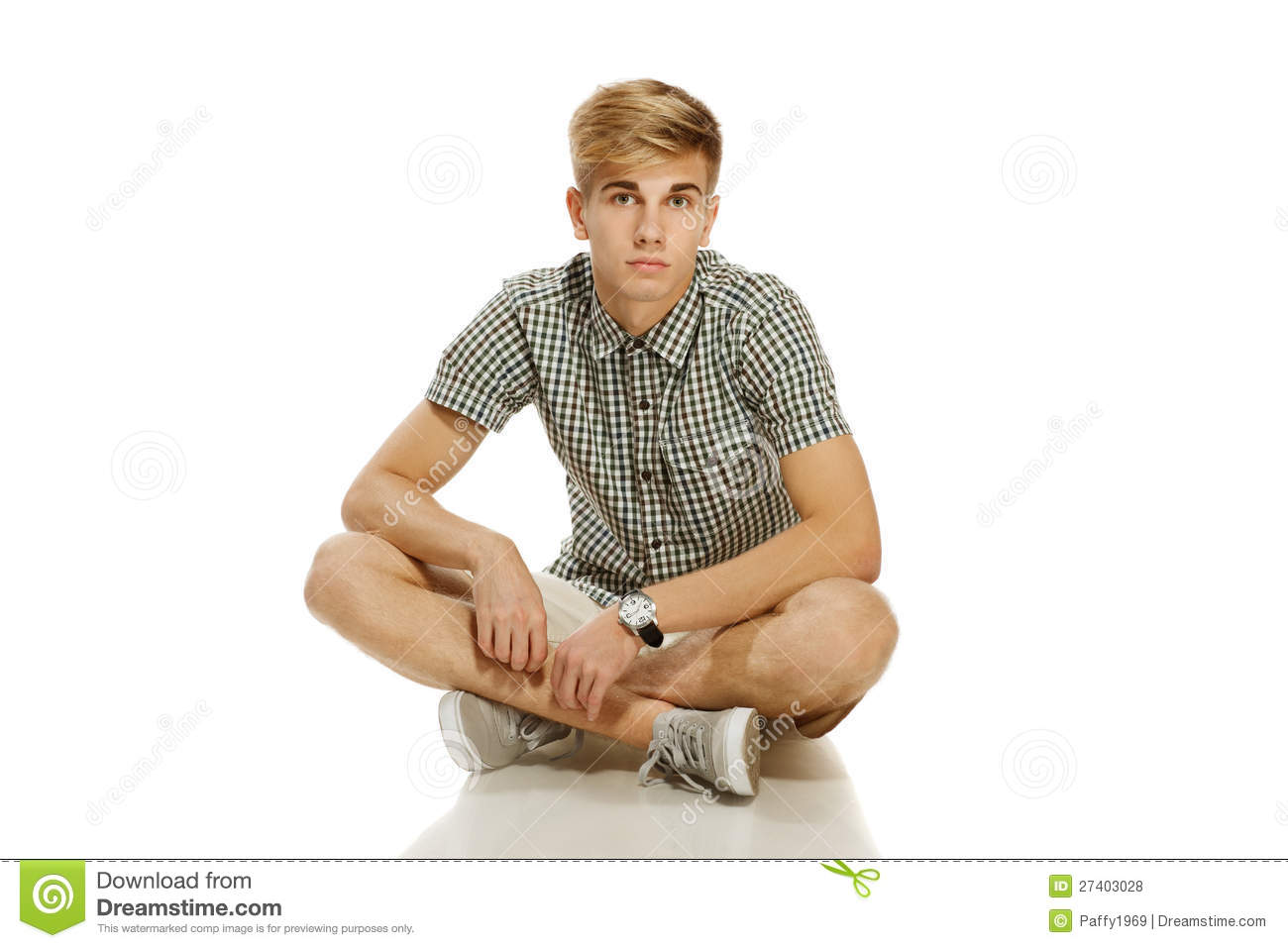 handsome youn man sitting on the floor royalty free stock
